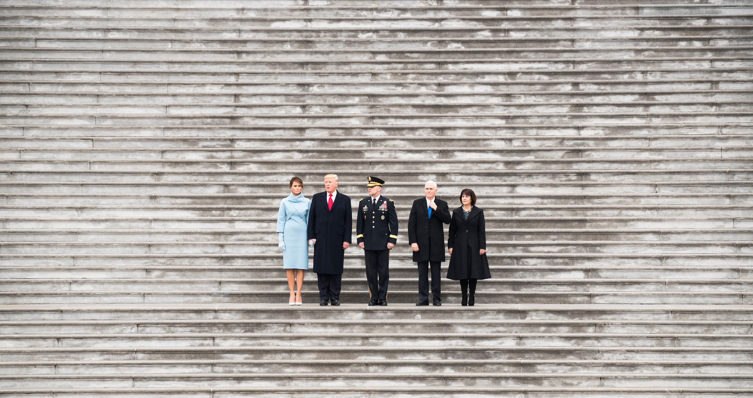 UNITED STATES - JANUARY 20: From left, First Lady Melania Trump, President Donald Trump, Major General Bradley Becker, Vice President Mike Pence, and his wife Karen Pence prepare to review the troops following the swearing in of Donald Trump as the 45th President of the United States on Friday, Jan. 20, 2017.(Photo By Bill Clark/CQ Roll Call)