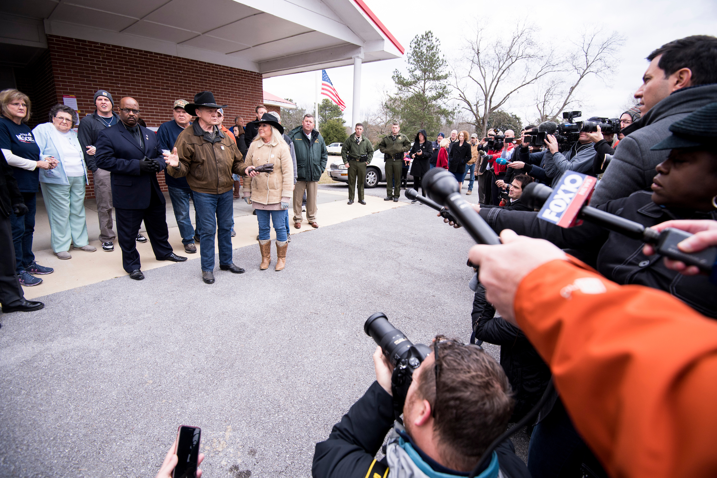 UNITED STATES - DECEMBER 11: Judge Roy Moore speaks to the media with his wife Kayla at his side after voting at the Gallant Volunteer Fire Department in Gallant, Ala., on Tuesday, Dec. 12, 2017. (Photo By Bill Clark/CQ Roll Call)