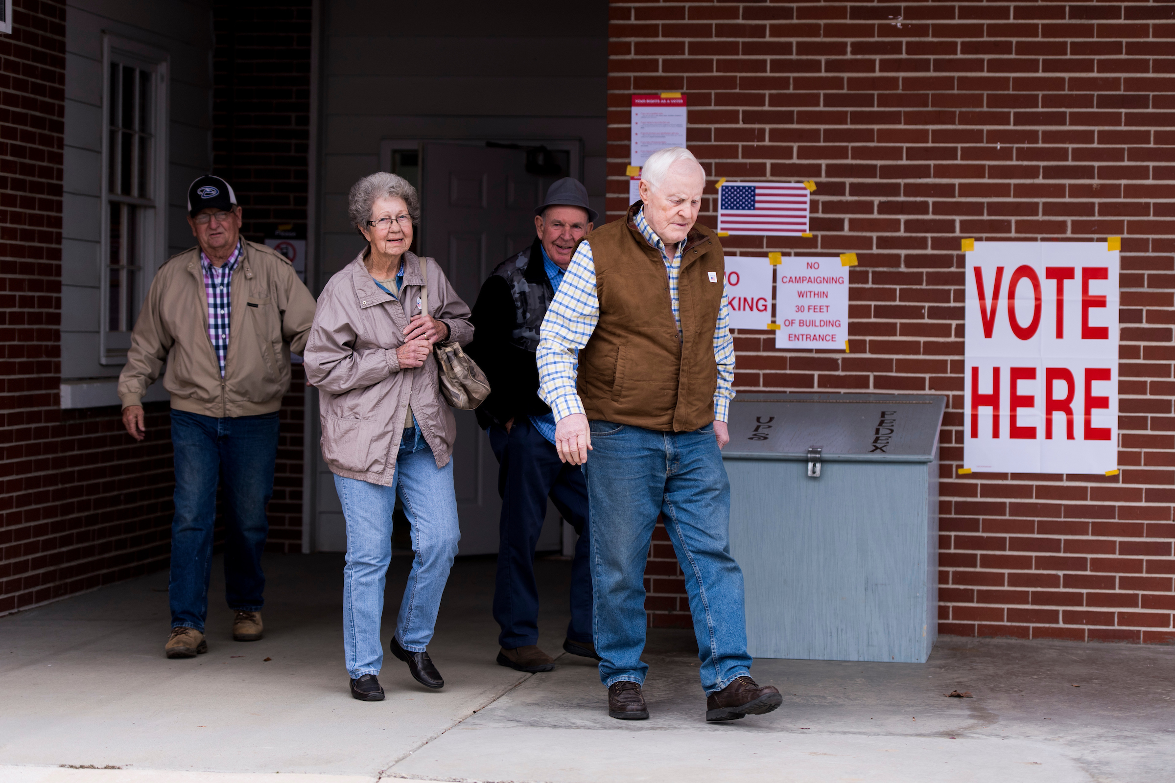UNITED STATES - DECEMBER 12: Voters leave the Gallant Volunteer Fire Department in Gallant, Ala., after voting in the Alabama U.S. Senate special election on Tuesday, Dec. 12, 2017. The polling station is where Judge Roy Moore votes. (Photo By Bill Clark/CQ Roll Call)
