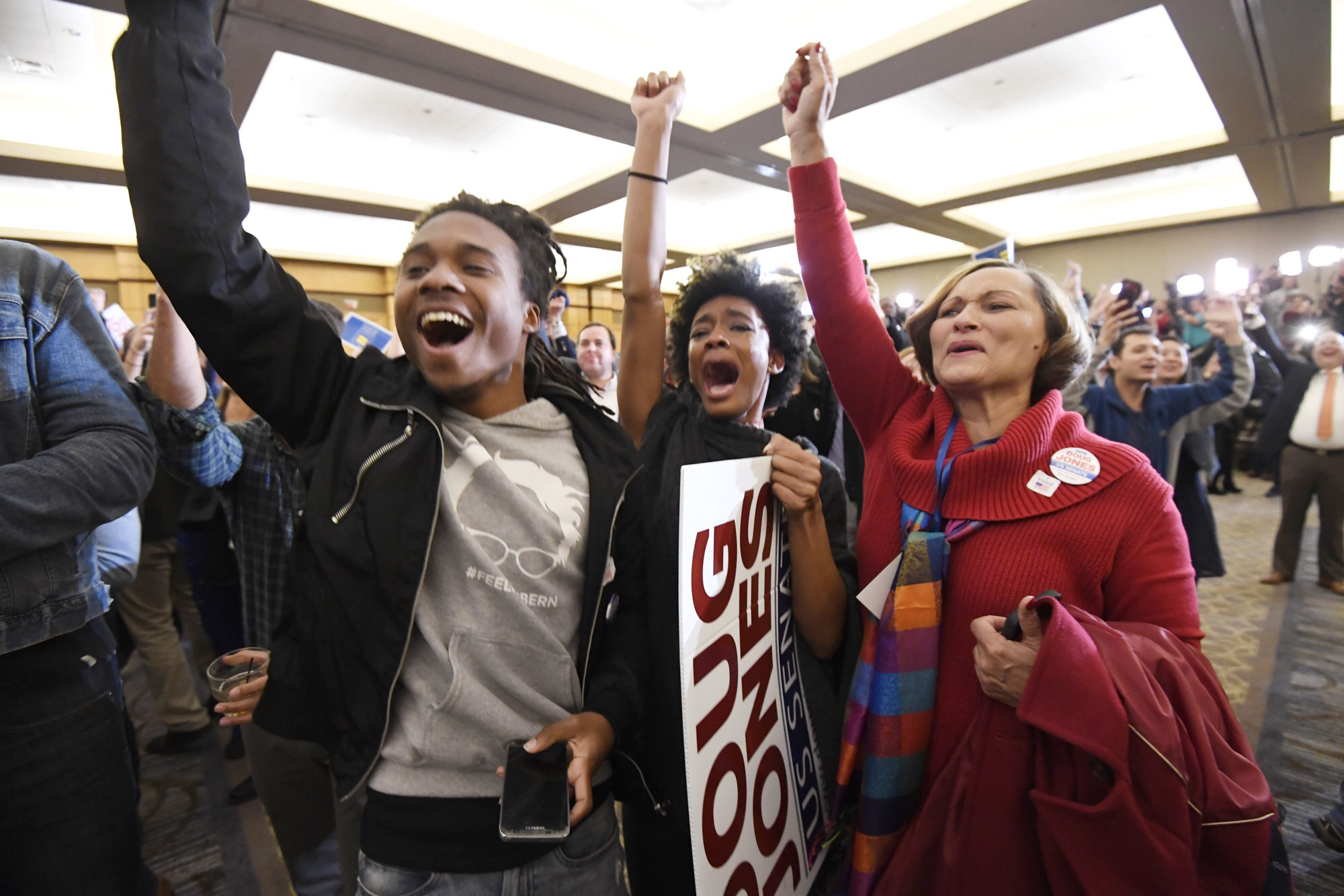 Senator-elect Doug Jones supporters cheer at the election night party in Birmingham on Tuesday evening. (Bill Clark/CQ Roll Call)