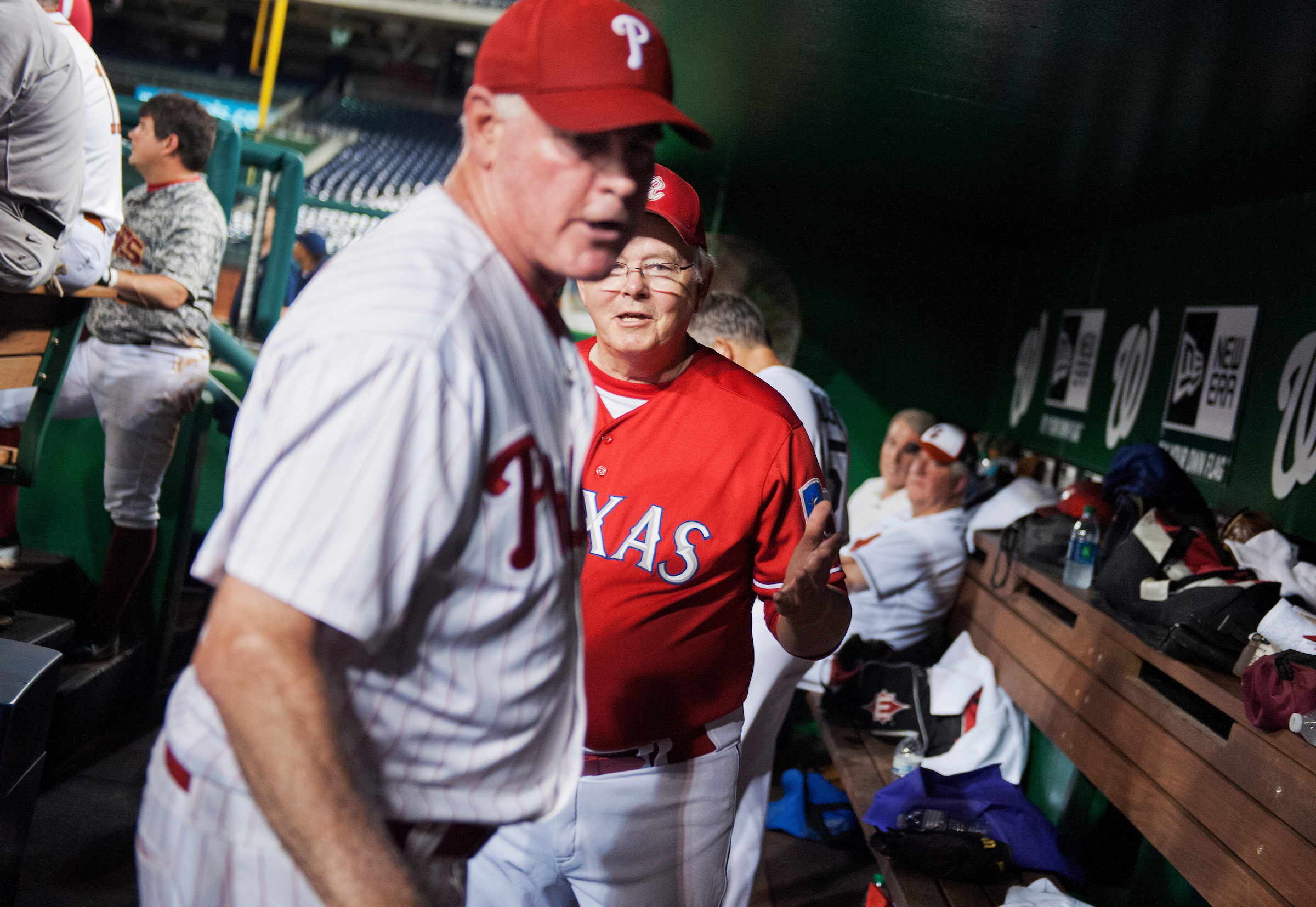Coach Joe Barton, R-Texas, tries to calm down Rep. Patrick Meehan, R-Pa., in the Republican dugout after Meehan was pulled from the mound during the 53rd Congressional Baseball Game from the Republican team dugout in Nationals Park, June 25, 2014. The Democrats prevailed over the Republicans 15-6 in a rain shortened game. (Tom Williams/CQ Roll Call)