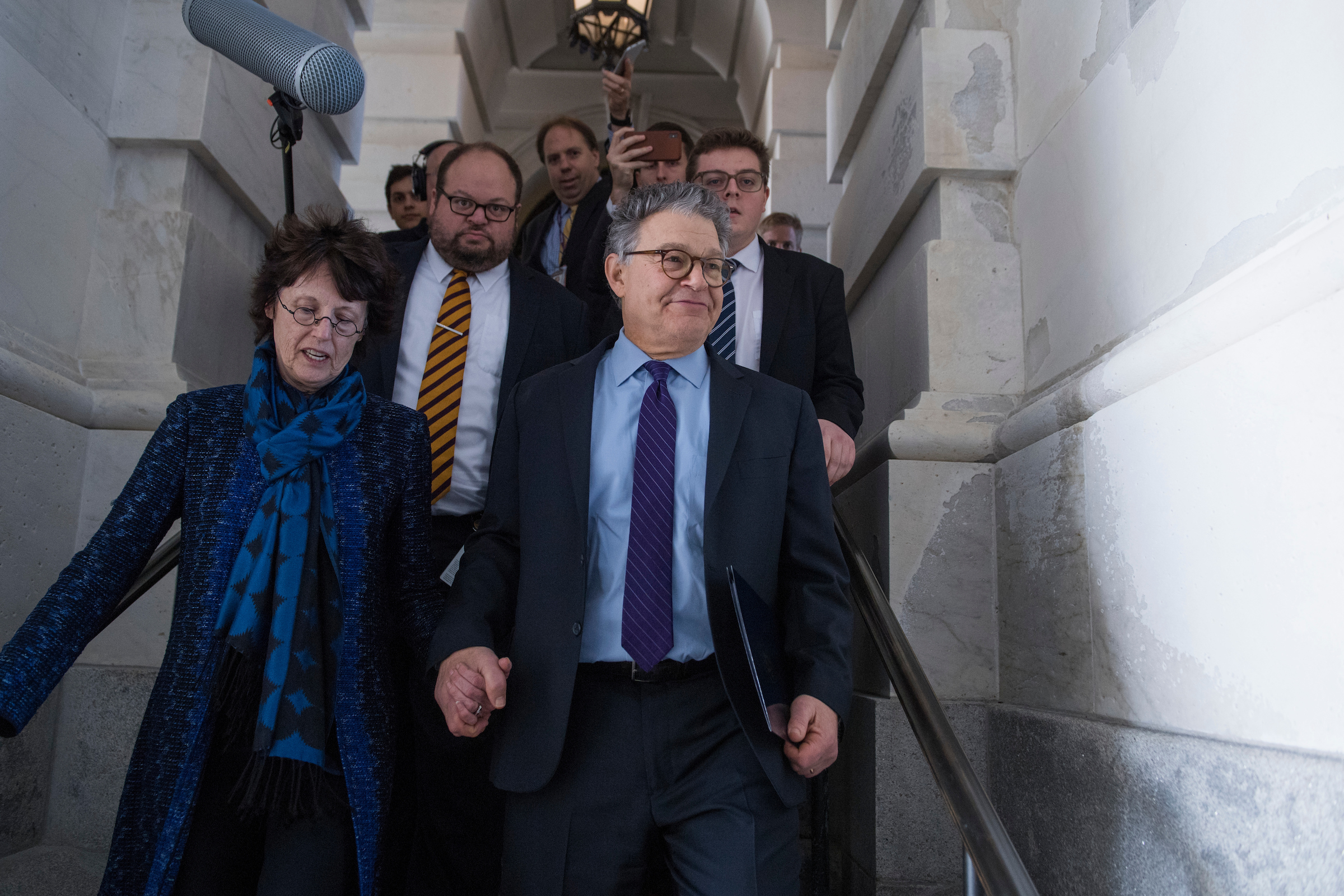 UNITED STATES - DECEMBER 07: Sen. Al Franken, D-Minn., and his wife Franni, leave the Capitol on December 7, 2017, after Franken announced on the Senate floor that he will resign his seat. (Photo By Tom Williams/CQ Roll Call)
