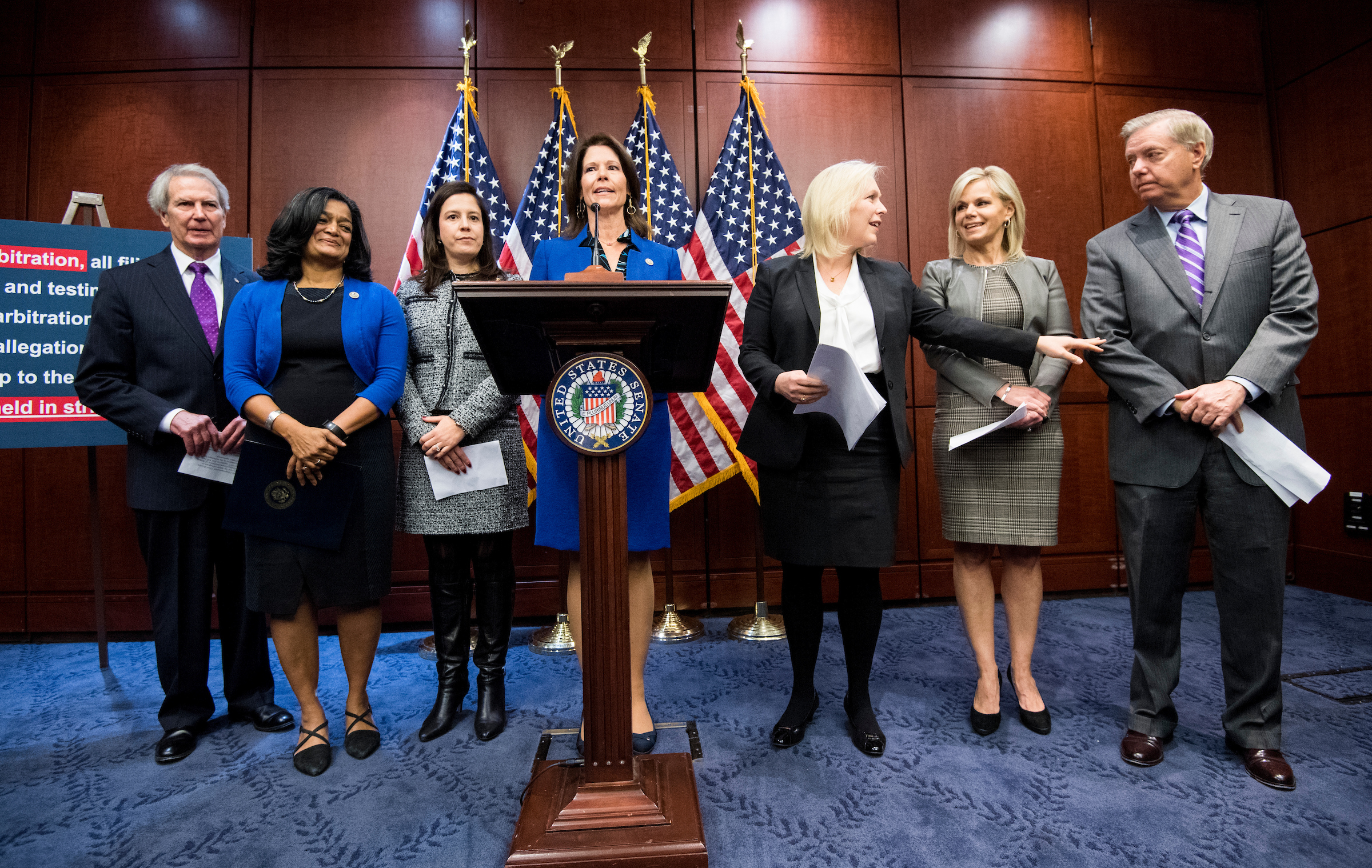 Sen. Kirsten Gillibrand, D-N.Y., third from right, joined other senators Wednesday in calling for Franken's resignation. She also appear that day with, from left, Reps. Walter Jones, R-N.C., Pramila Jayapal, D-Wash., and Cheri Bustos, D-Ill., Gretchen Carlson, and Sen. Lindsey Graham, R-S.C., on a new bipartisan bill to prevent sexual harassment and discrimination in the workplace. (Bill Clark/CQ Roll Call)