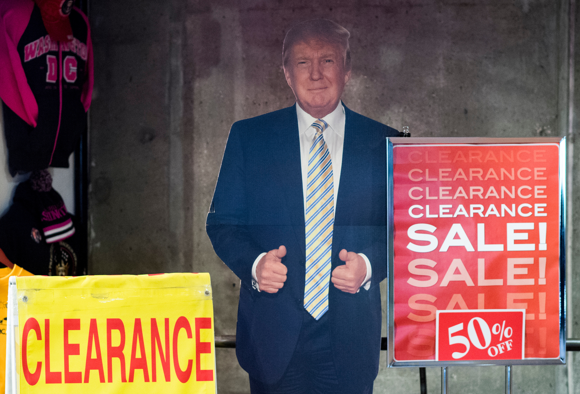 A cardboard cutout of President Donald Trump stands outside a souvenir store at the entrance to the McPherson Square Metro subway station near the White House on Monday. (Bill Clark/CQ Roll Call)