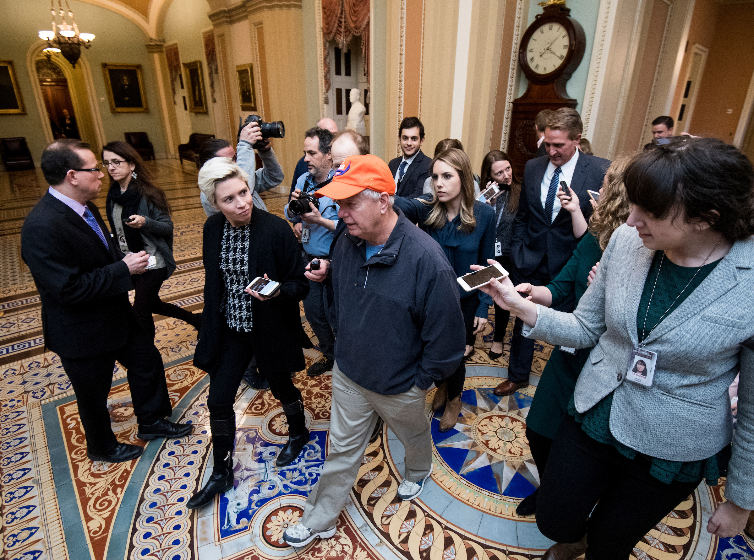 From left, Sen. Lindsey Graham, R-S.C., and Sen. Jeff Flake, R-Ariz., leave after meeting in Senate Leader McConnell's office as Senate moderates try to find a way to end the government shutdown on Sunday. (Bill Clark/CQ Roll Call)