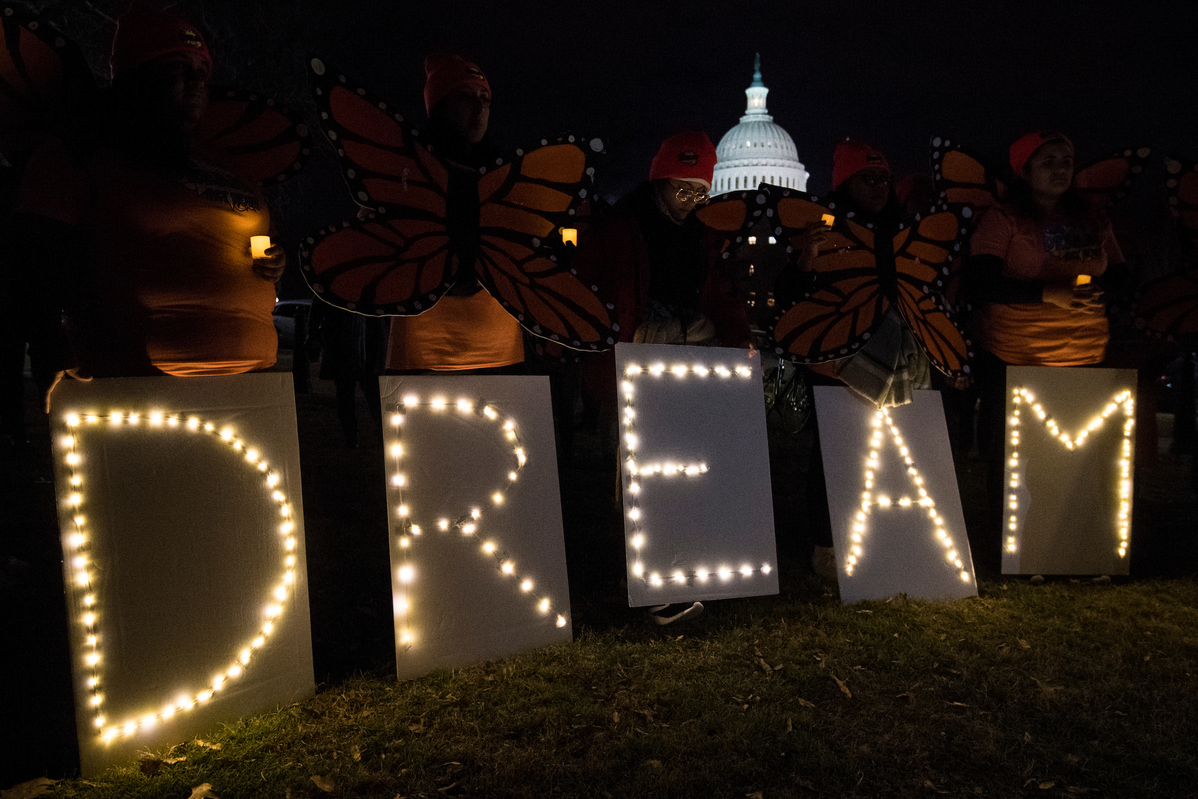 Dreamers protest outside of the Capitol calling for passage of the Dream Act as Congress works to find a way to end the government shutdown on Sunday evening. (Bill Clark/CQ Roll Call)