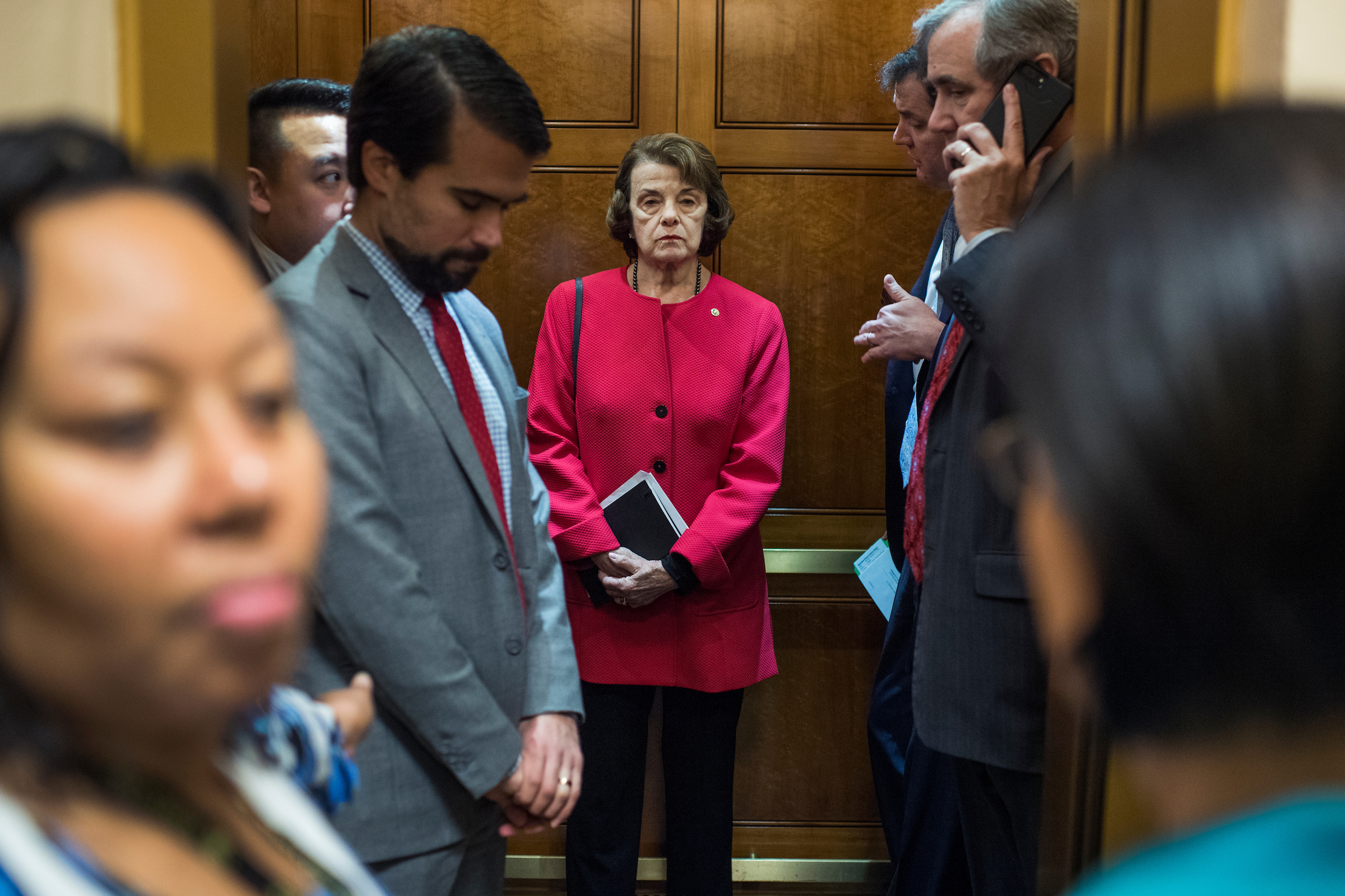 Sen. Dianne Feinstein, D-Calif., makes her way to a meeting in the Capitol as Congress works to end the government shutdown on Monday. (Tom Williams/CQ Roll Call)