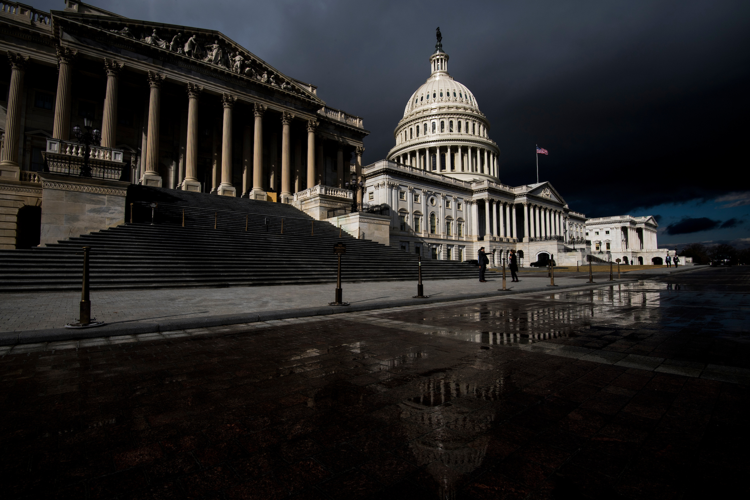 Storm clouds pass over the dome of the U.S. Capitol building on Tuesday. (Bill Clark/CQ Roll Call)