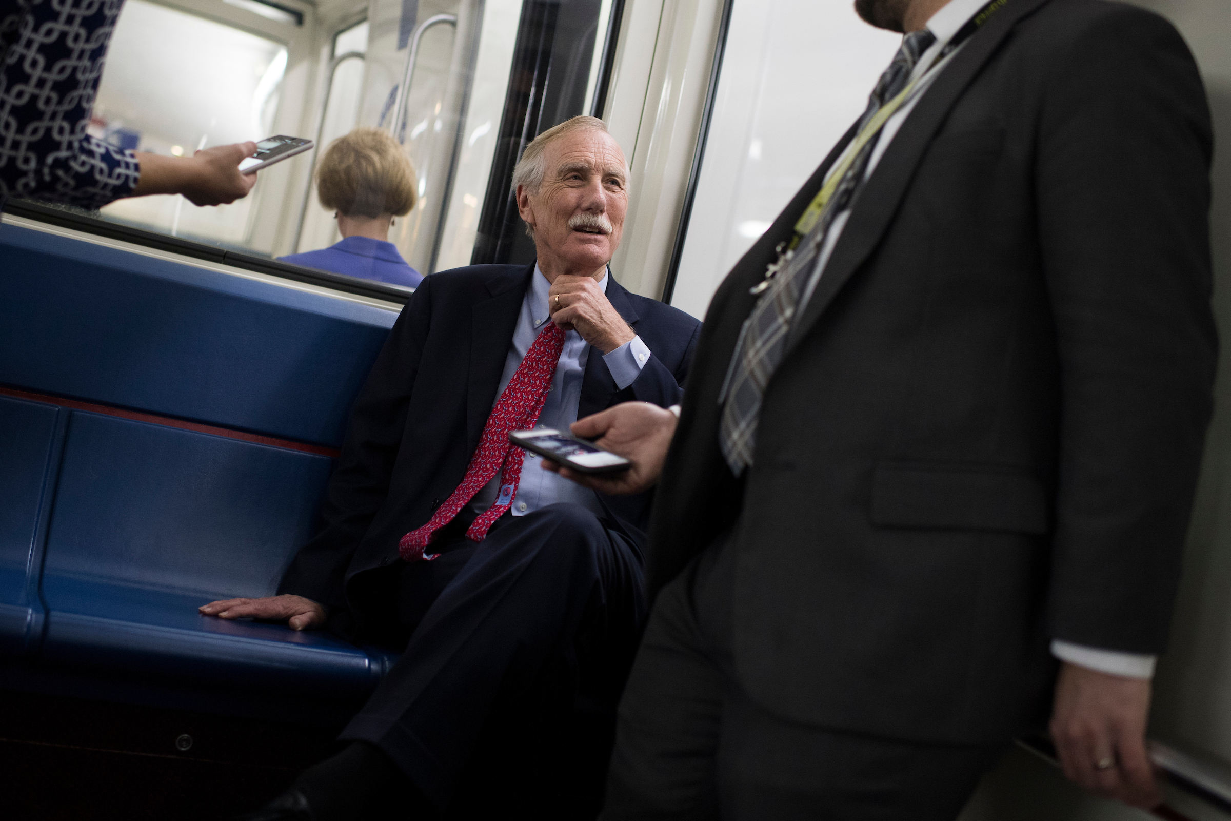 Sen. Angus King, I-Maine, talks with reporters on the Senate subway after the Senate Policy luncheons in the Capitol on Tuesday. (Tom Williams/CQ Roll Call)