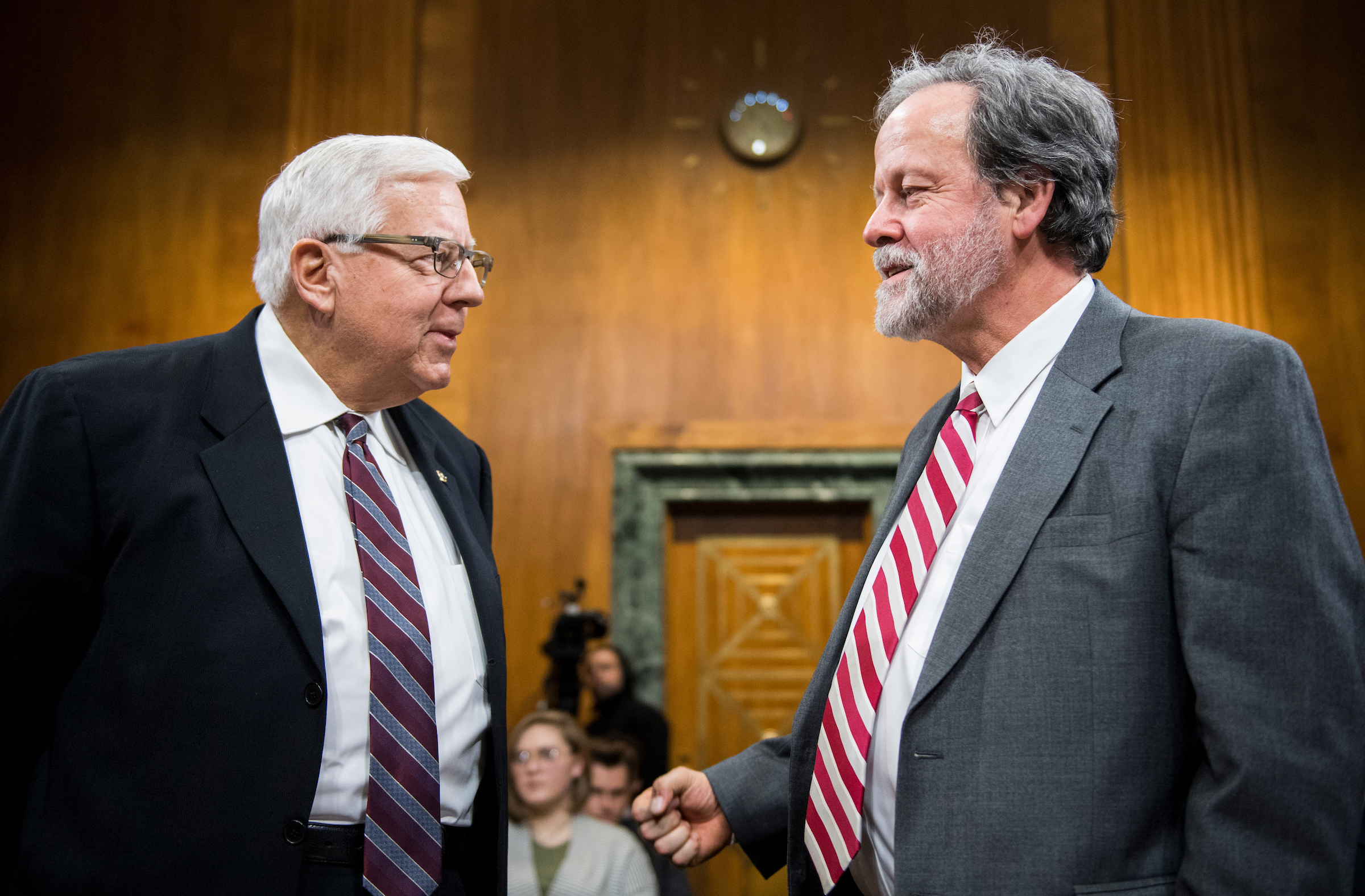 Chairman Mike Enzi, Wyo., left, speaks with CBO Director Keith Hall before the start of the Senate Budget Committee hearing on oversight of the Congressional Budget Office on Wednesday. (Bill Clark/CQ Roll Call)