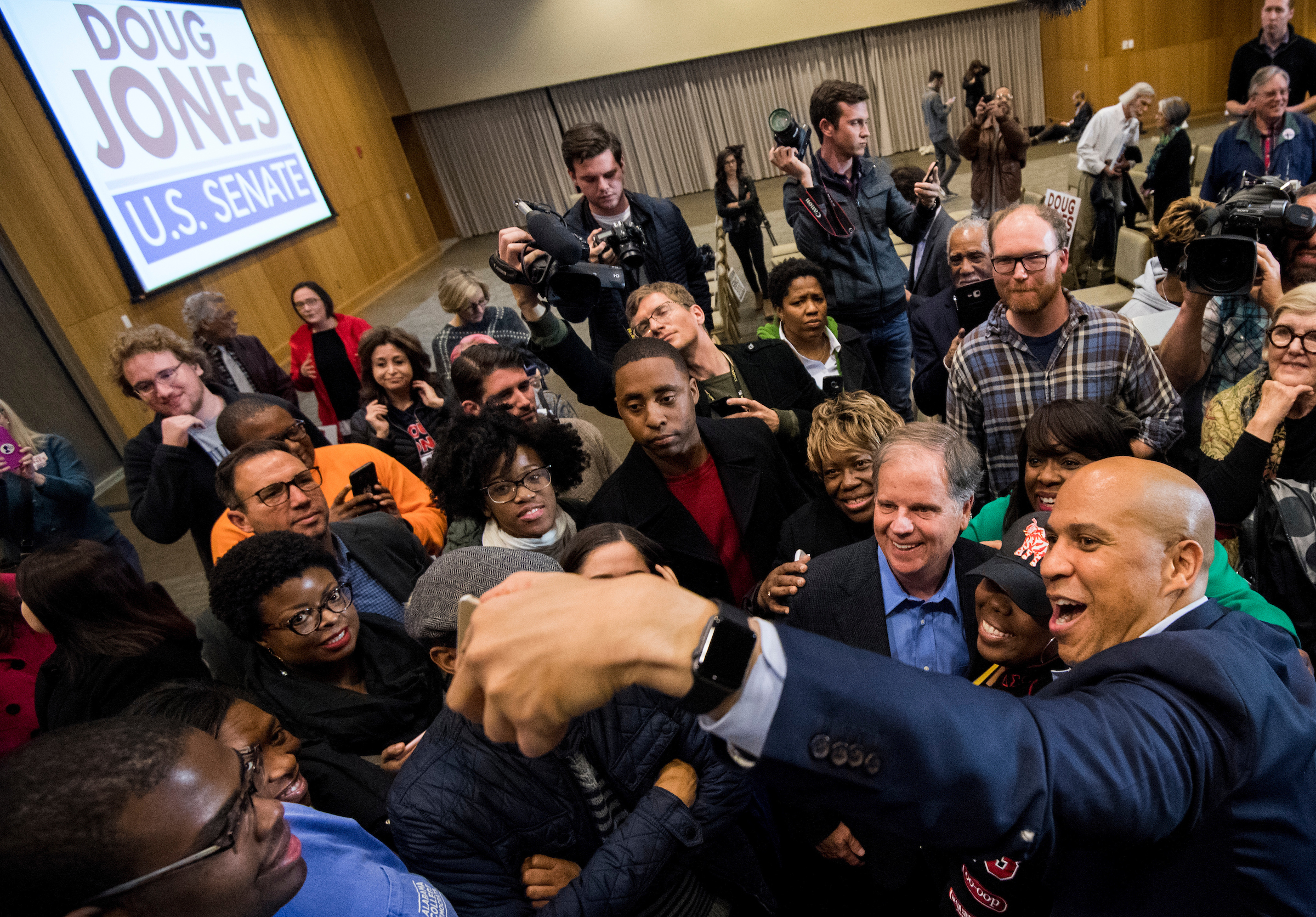 Sen. Cory Booker, D-N.J., right, takes selfie photos with Rep. Terri Sewell, D-Ala., and Democratic candidate for Senate Doug Jones at the end of a campaign rally for Jones at Alabama State University in Montgomery, Ala., on Saturday, Dec. 9, 2017. (Bill Clark/CQ Roll Call file photo)