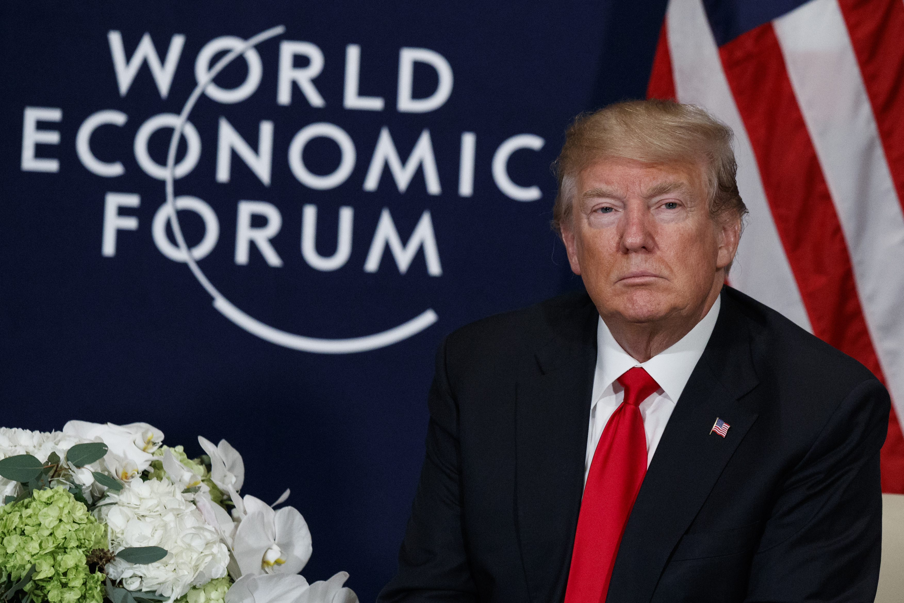 U.S. President Donald Trump listens during a meeting with Rwandan President Paul Kagame at the World Economic Forum, Friday, Jan. 26, 2018, in Davos, Switzerland. (AP Photo/Evan Vucci)