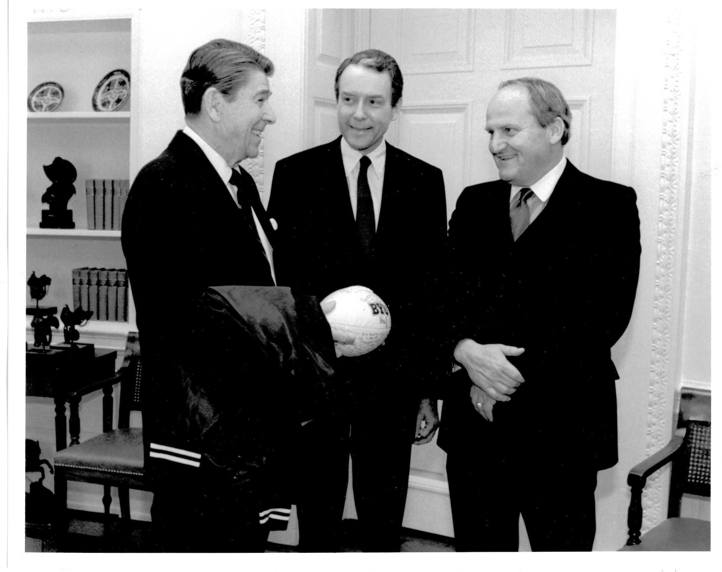 Sen. Orrin Hatch (R-UT) and LaVell Edwards, coach of the Brigham Young University football team, pay a courtesy call on Pres. Ronald Reagan in the Oval Office on Jan. 14, 1985. This meeting came just a week before Pres. Reagan's second inauguration, and followed the successful season in which Coach Edwards led the BYU Cougars to a 13-0 record and the national championship as determined by the consensus of the AP, UPI, USAToday and most other major polls, in those pre-Bowl-Championship-Series days. photograph: Pete Souza, The White House.