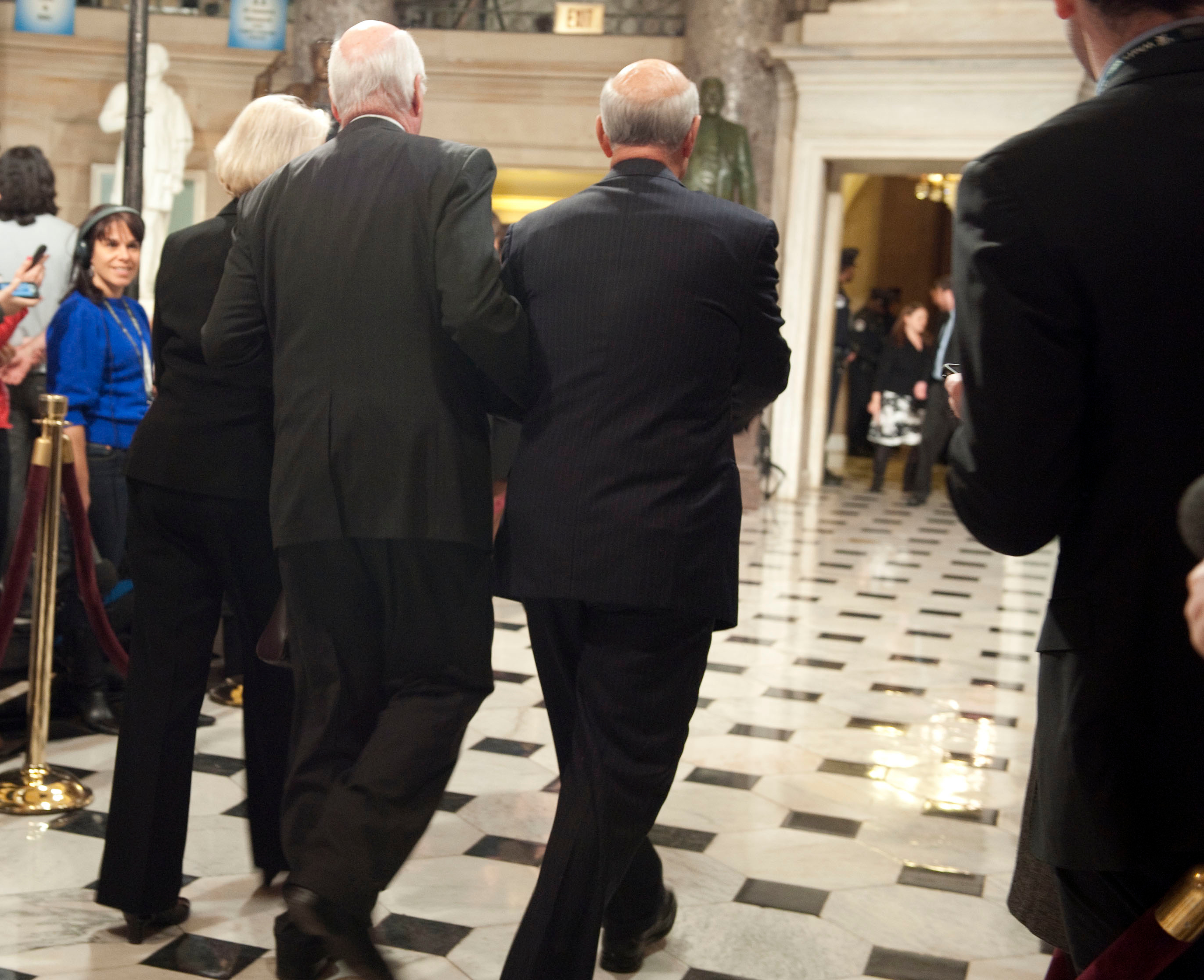 UNITED STATES - January 25, 2011 : Patrick Leahy, D-VT., (center) his wife Marcelle and Pat Roberts, R-KS., walk through Statuary Hall in the U.S. Capitol on their way to the House Chamber to hear President Barack Obama deliver his first State of the Union Address before a joint session of Congress on January 25, 2011. (Photo By Douglas Graham / CQ/Roll Call)