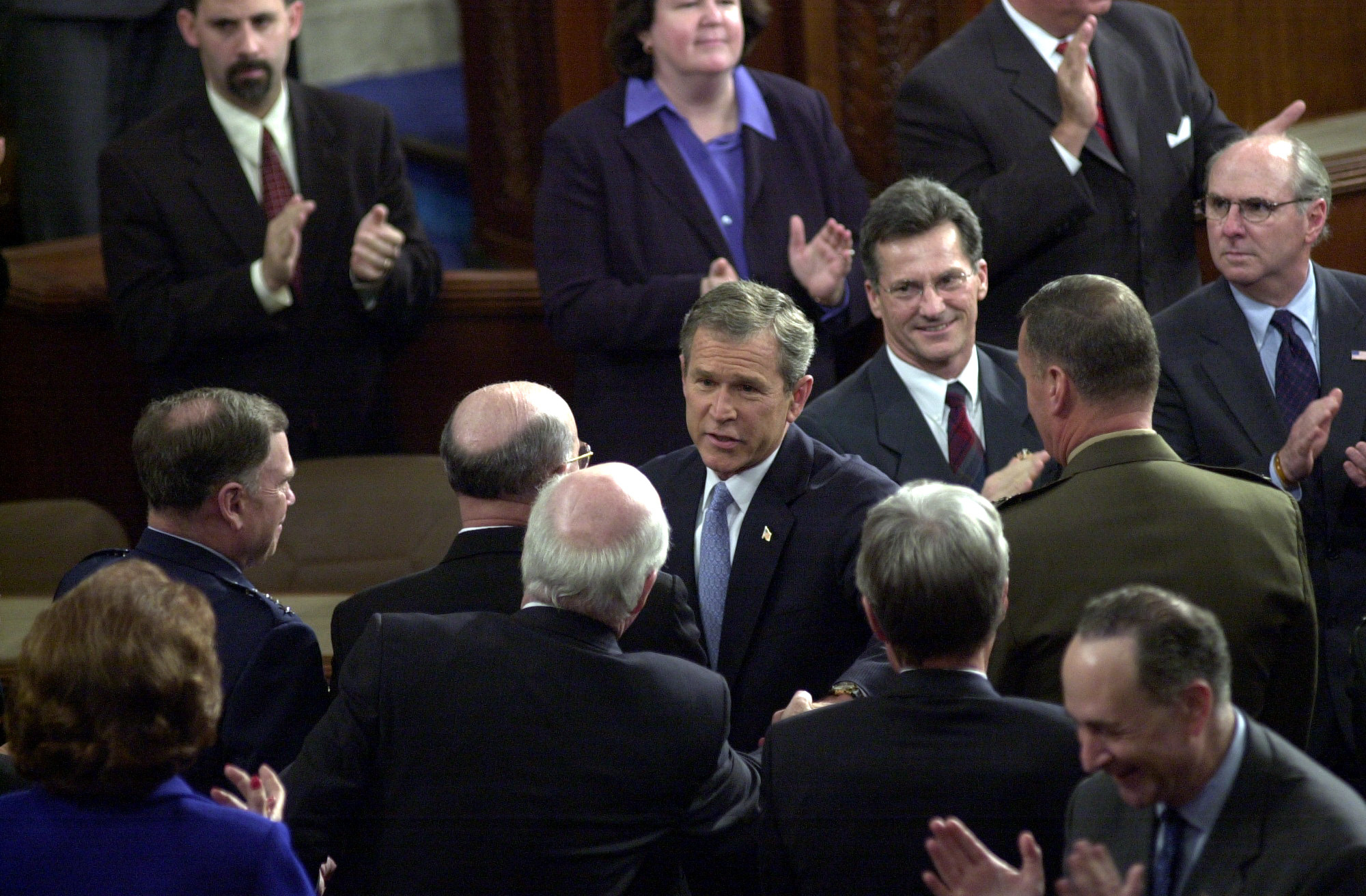 Union27/012902 -- President George W. Bush greets Patrick J. Leahy, D-Vt., before the State of the Union address.