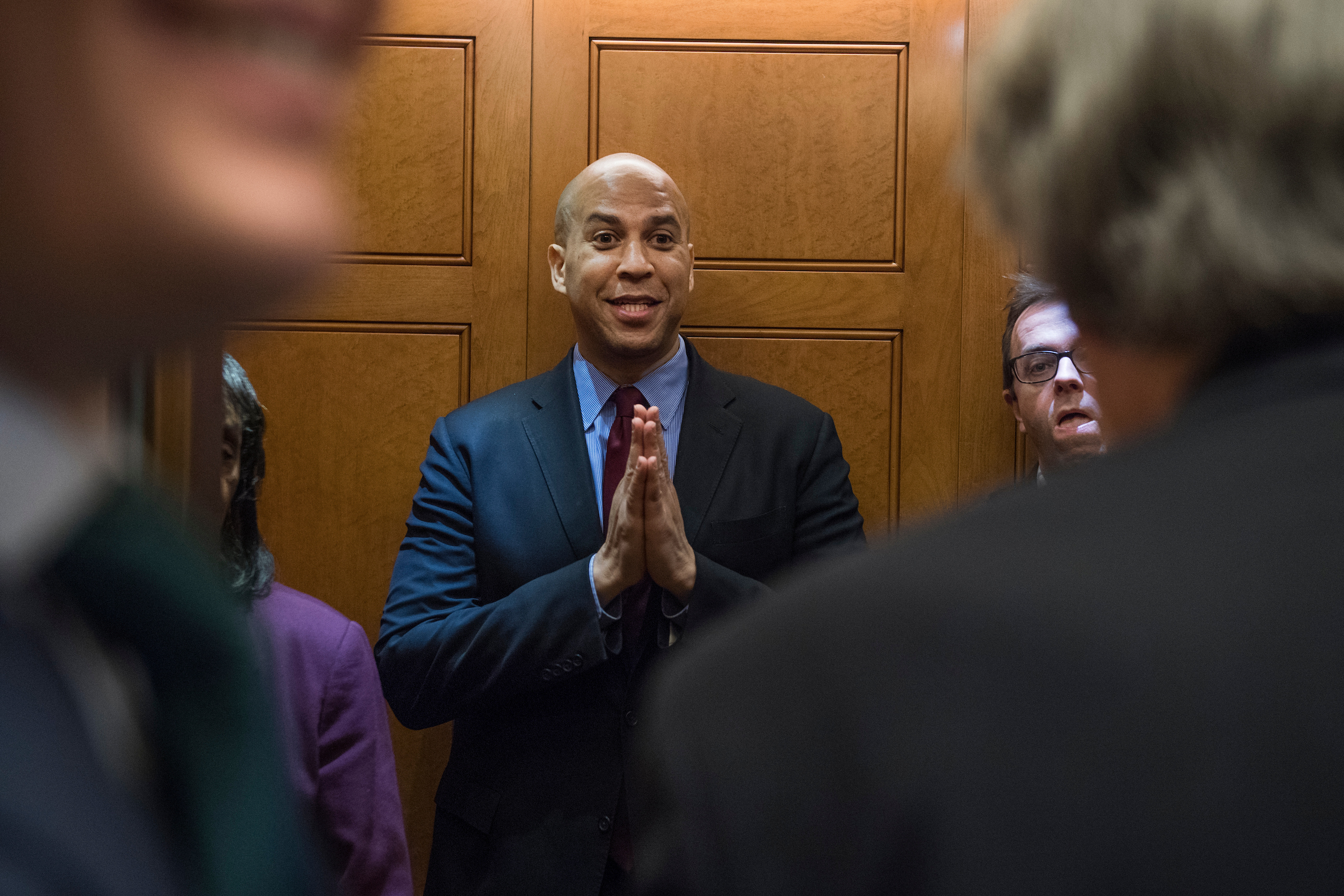 Sen. Cory Booker, D-N.J., boards an elevator before a vote in the Capitol on January 18, 2018. (Photo By Tom Williams/CQ Roll Call)