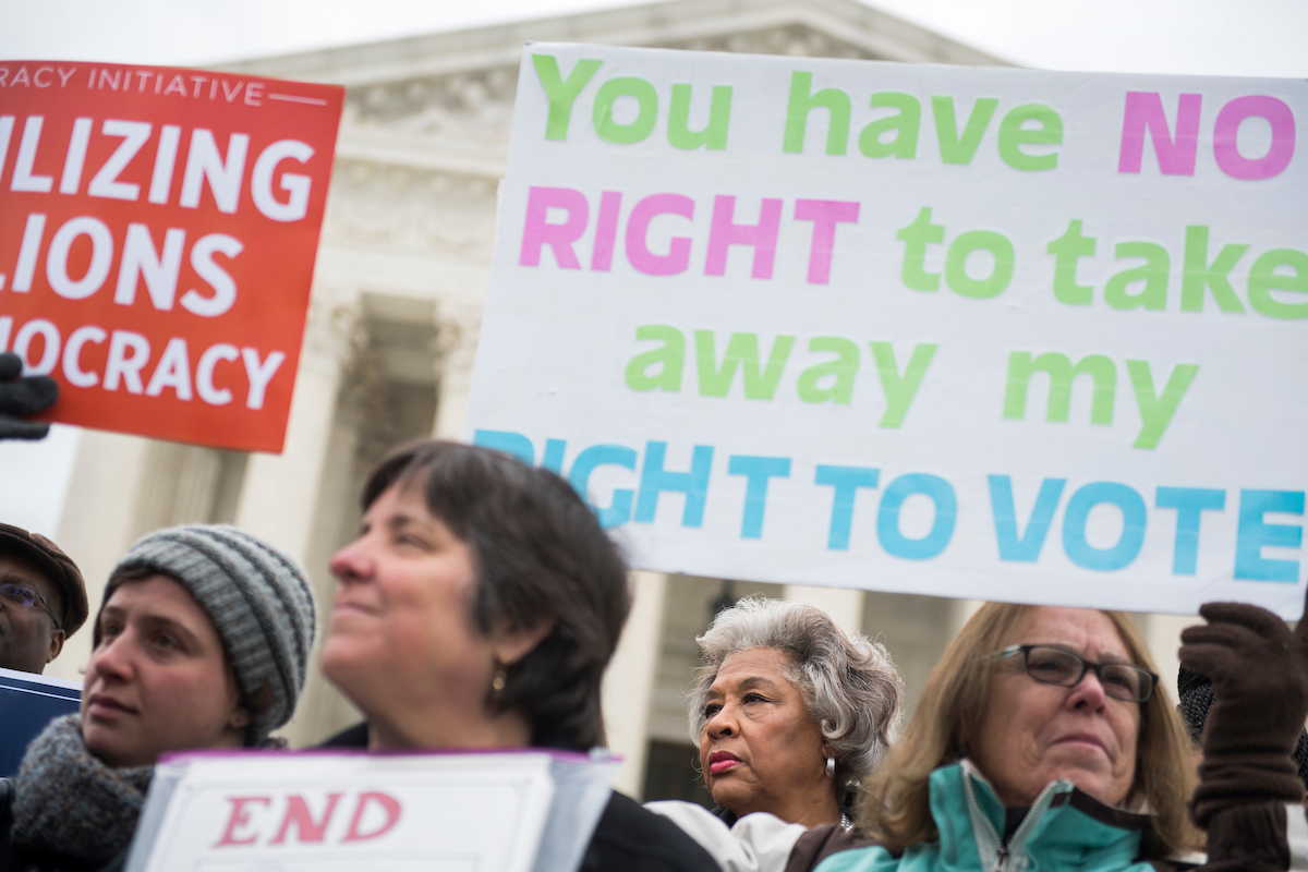 UNITED STATES - JANUARY 10: Rep. Joyce Beatty, D-Ohio, second from right, is seen during a rally outside the Supreme Court on January 10, 2018, to oppose Ohio's voter purging system. The court heard arguments on whether Ohio has been too strict in setting in motion a voter registration removal process if the individual hasen't voted in a federal election for two years. (Photo By Tom Williams/CQ Roll Call)