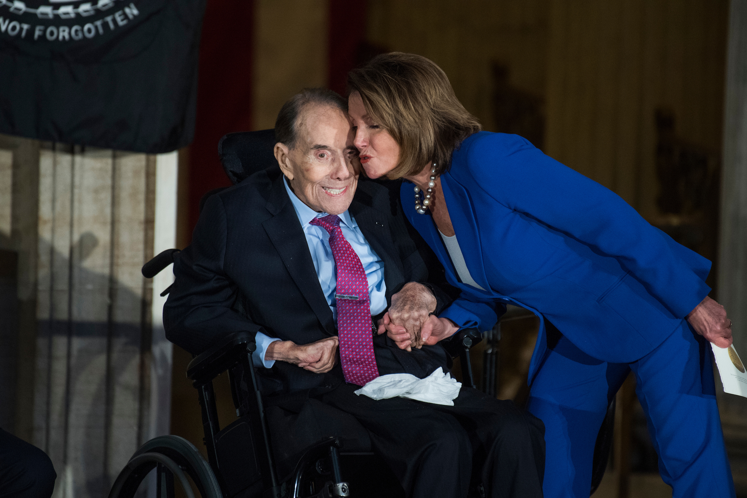 "UNITED STATES - JANUARY 17: House Minority Leader Nancy Pelosi, D-Calif., greets former Sen. Bob Dole, R-Kan., during a Congressional Gold Medal ceremony in the Capitol rotunda to honor Dole as a ""soldier, legislator, and statesman,"" on January 17, 2018. (Photo By Tom Williams/CQ Roll Call)"