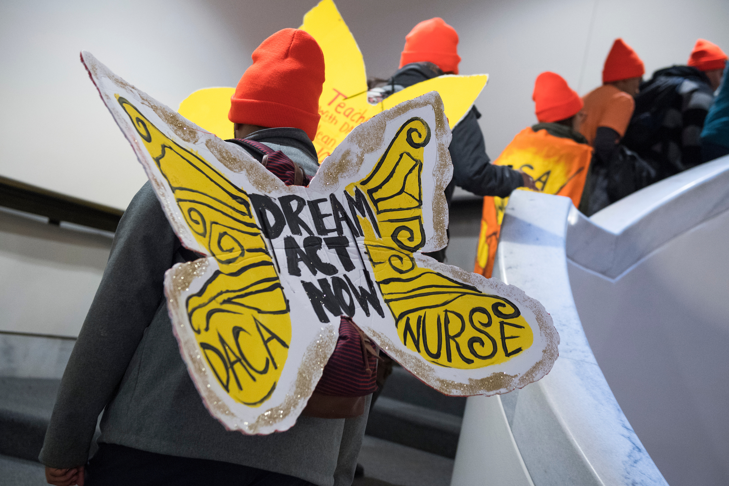 Demonstrators with United We Dream and others rally in the atrium of Hart Building on January 16, 2018, to call on congress to pass the Dream Act, that protects young immigrants from deportation. (Photo By Tom Williams/CQ Roll Call)