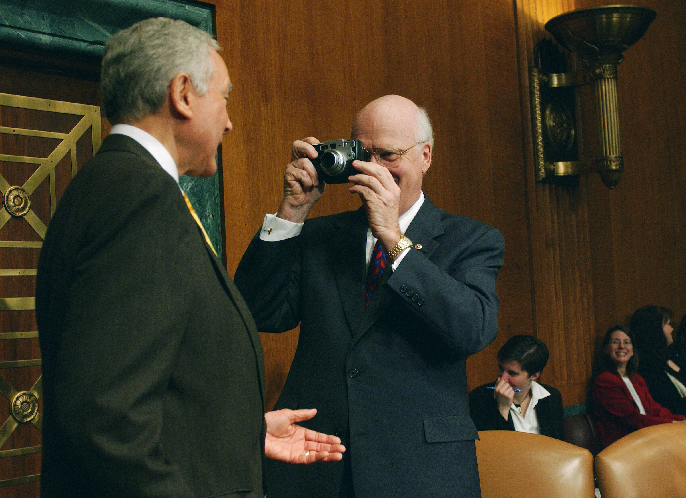 Smile! Then-Senate Judiciary Chairman Patrick J. Leahy snaps a picture of Hatch in 2002 with a digital camera he asked to see from a news photographer in the well. (Scott J. Ferrell/Congressional Quarterly)
