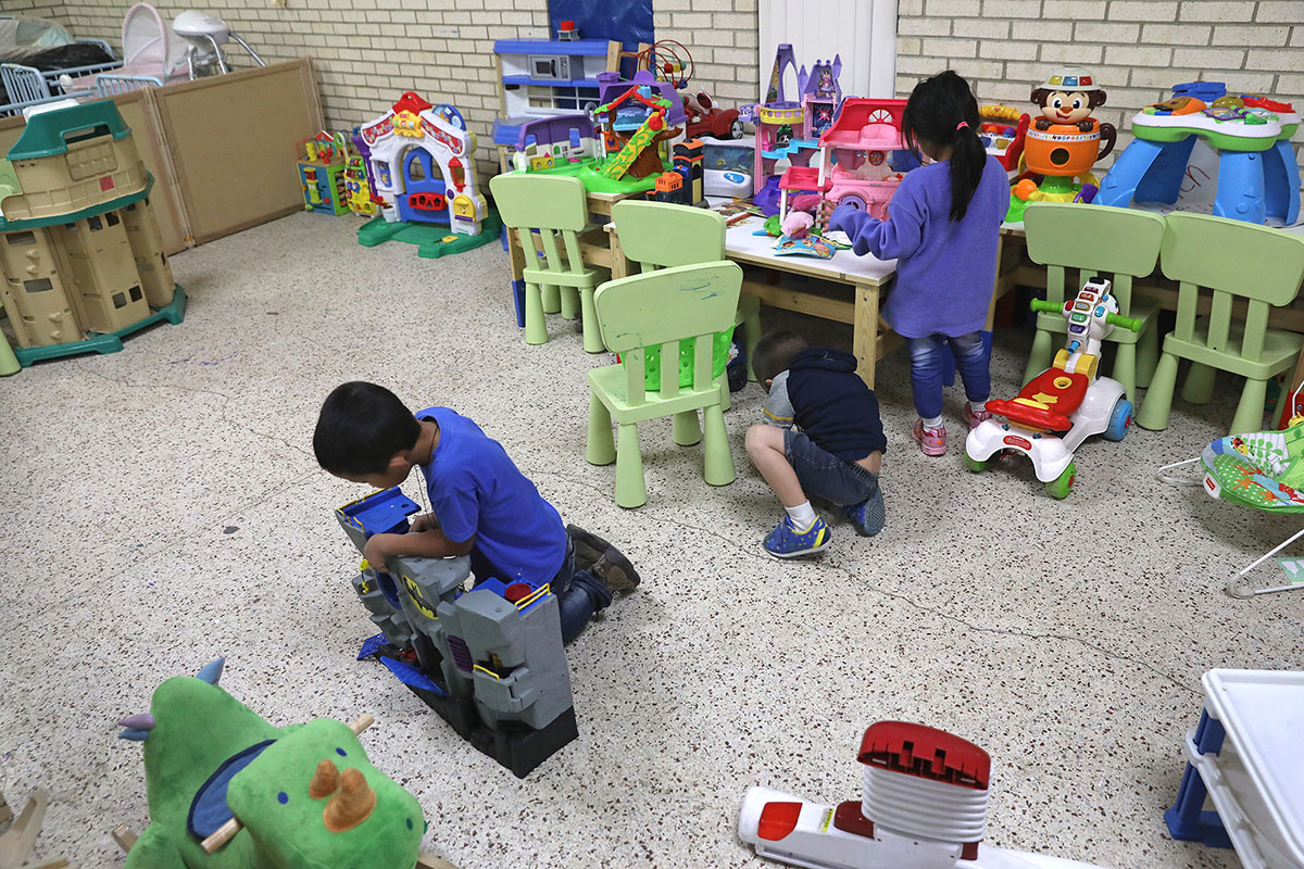 MCALLEN, TX - JANUARY 06: Immigrant children play at the Catholic Charities Respite Center on January 6, 2017 at the Sacred Heart Catholic Church in McAllen, Texas. The center helps thousands of immigrants, many having crossed illegally from Mexico into the United States to seek asylum. Most families are from Central America and are first detained by U.S. Customs and Border Protection agents, who process them and release them for their onward journey to cities around the United States. They are required to appear in immigration court at a later date for their asylum cases to be heard. (Photo by John Moore/Getty Images)