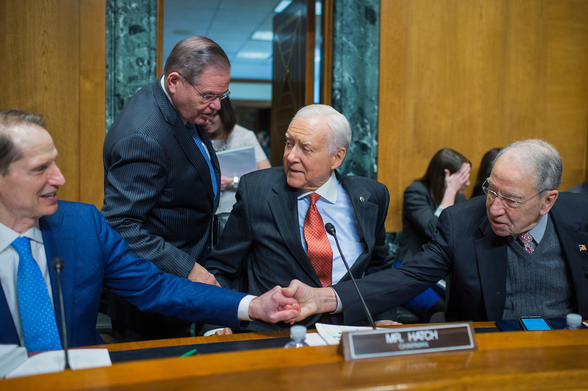 UNITED STATES - JANUARY 09: From left, Sen. Ron Wyden, D-Ore., ranking member, Sen. Bob Menendez, D-N.J., Chairman Orrin Hatch, R-Utah, and Sen. Charles Grassley, R-Iowa, are seen during the Senate Finance Committee confirmation hearing for Alex Azar, nominee to be Department of Health and Human Services secretary, in Dirksen Building on January 9, 2018. (Photo By Tom Williams/CQ Roll Call)
