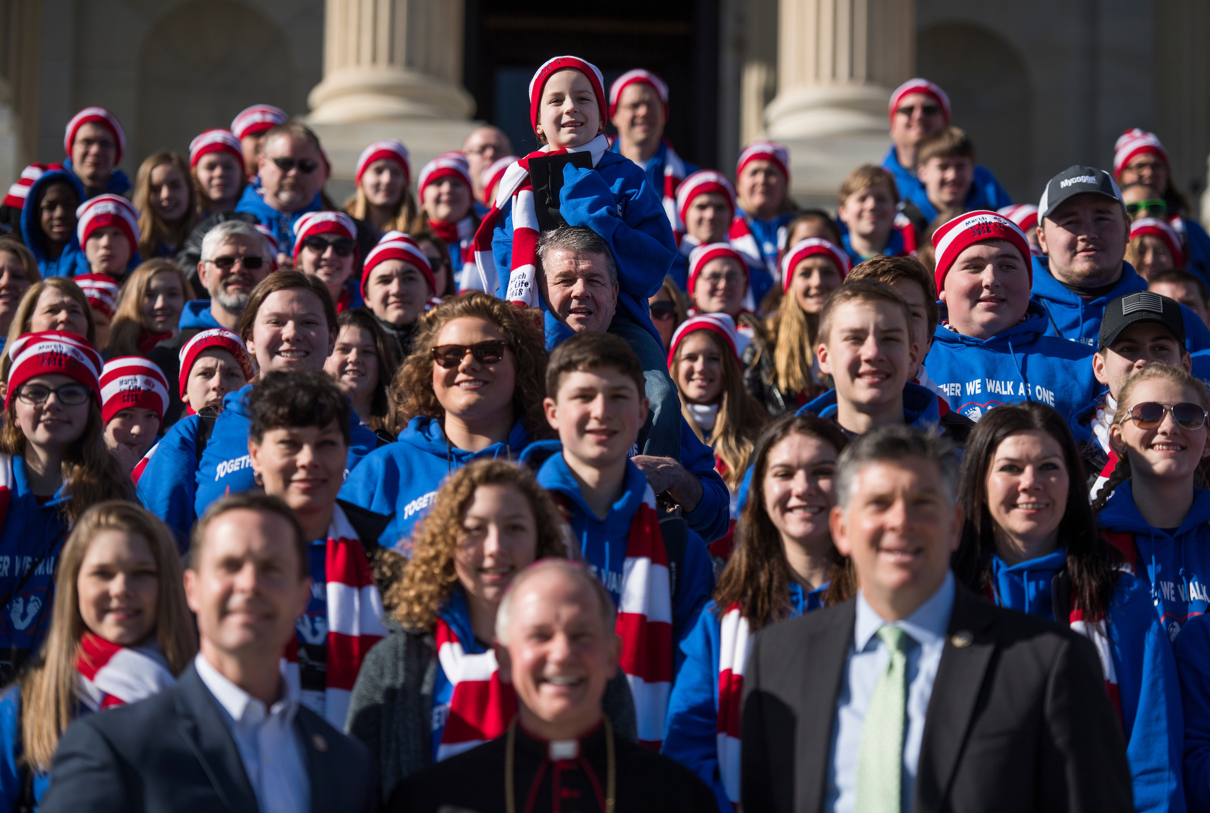 UNITED STATES - JANUARY 19: Bottom row from right, Rep. Rodney Davis, R-Ill., Bishop Thomas Paprocki of Springfield, Ill., and Rep. Darin LaHood, R-Ill., pose on the Capitol steps with attendees of the March for Life after the House's last scheduled vote as the Senate considers the continuing resolution to fund the government on January 19, 2018. (Photo By Tom Williams/CQ Roll Call)