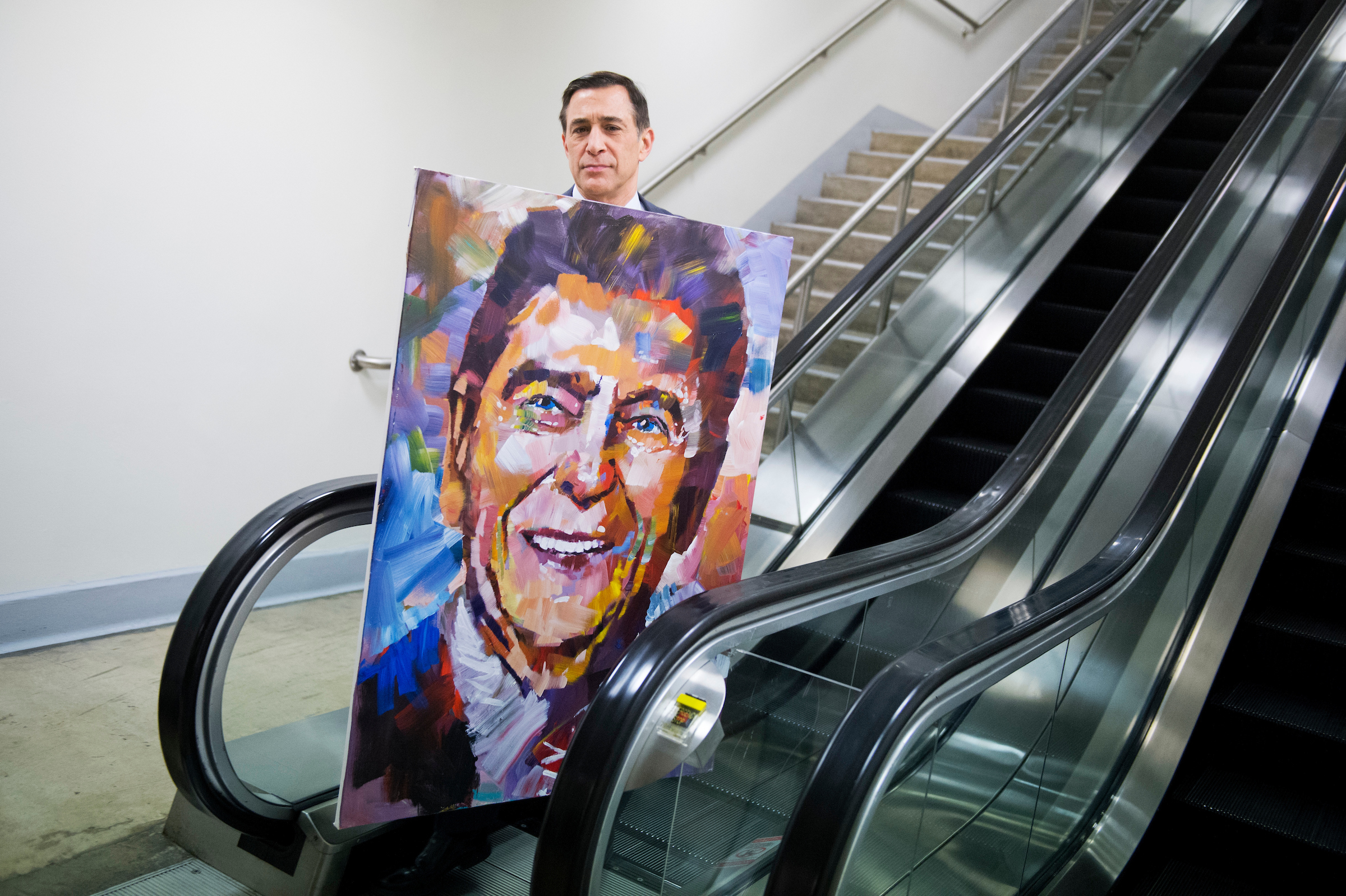 Rep. Darrell Issa, R-Calif., seen here with a painting of Ronald Reagan by artist Steve Penley, will retire at the end of this term. (Tom Williams/CQ Roll Call file photo)
