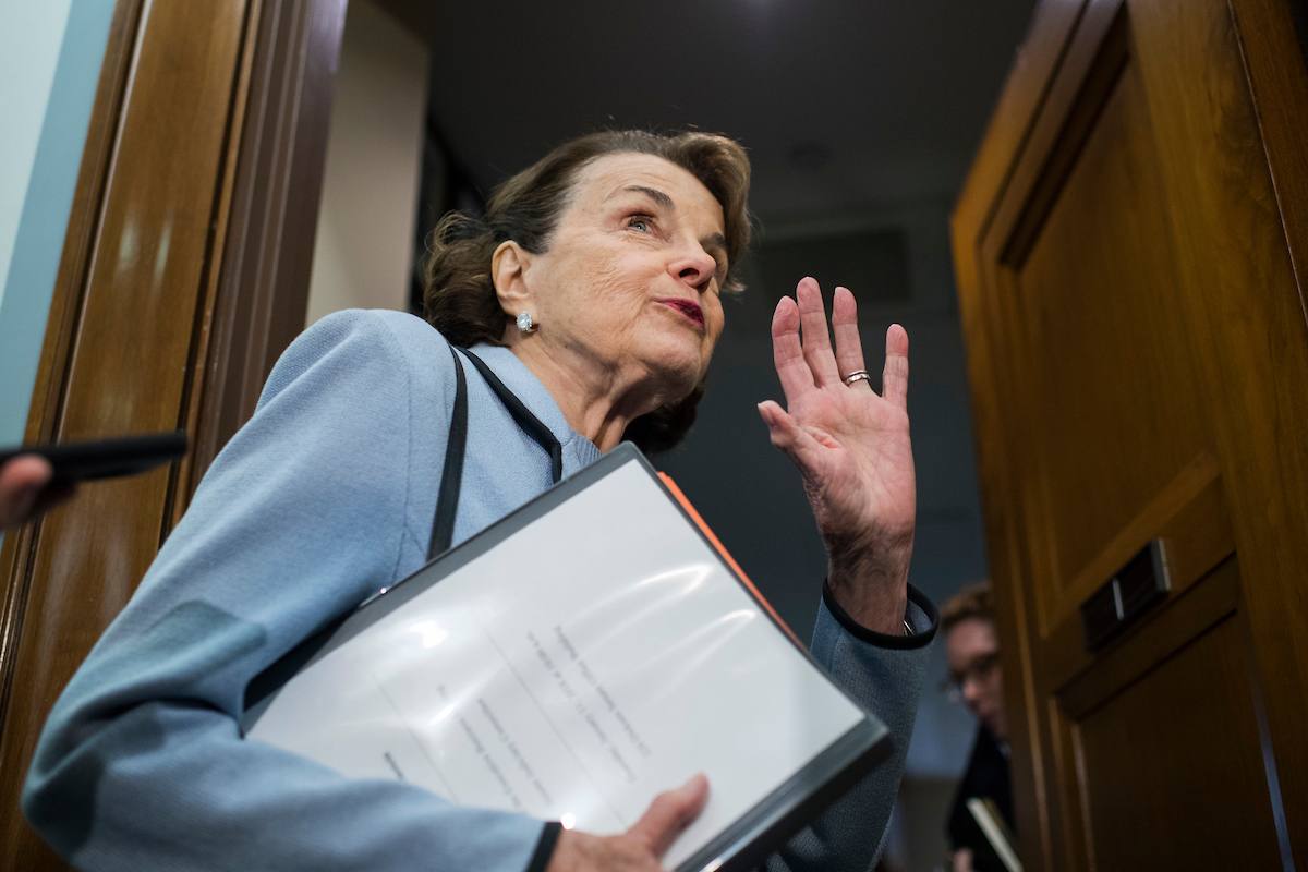 "UNITED STATES - JANUARY 11: Sen. Dianne Feinstein, D-Calif., talks with reporters before a Senate Judiciary Committee markup in Dirksen Building on the ""Amy, Vicky, and Andy Child Pornography Victim Assistance Act of 2017"" and judicial nominations on January 11, 2018. (Photo By Tom Williams/CQ Roll Call)"