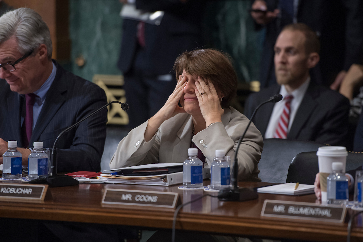 "UNITED STATES - JANUARY 11: Sen. Amy Klobuchar, D-Minn., is seen during a Senate Judiciary Committee markup in Dirksen Building on the ""Amy, Vicky, and Andy Child Pornography Victim Assistance Act of 2017"" and judicial nominations on January 11, 2018. (Photo By Tom Williams/CQ Roll Call)"