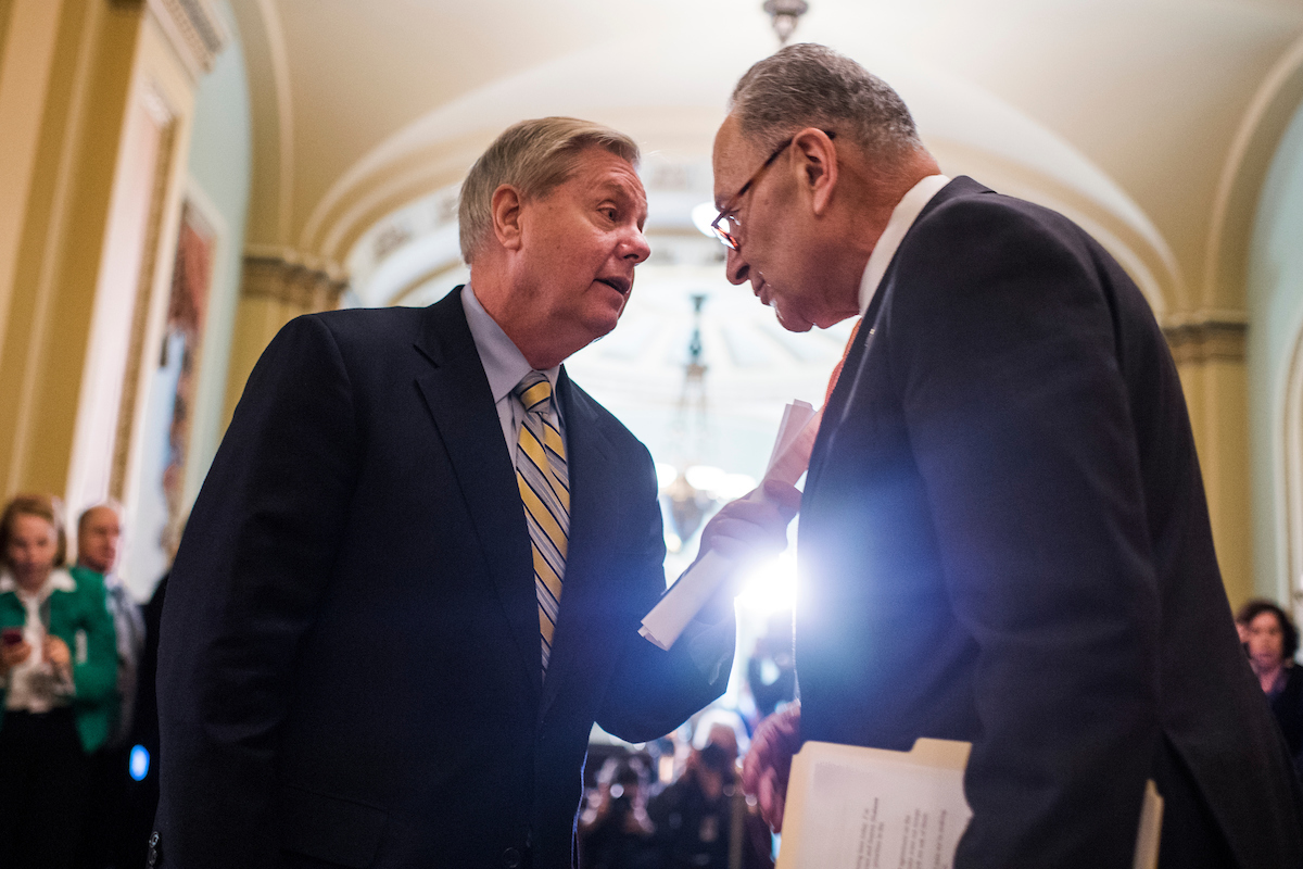 UNITED STATES - JANUARY 09: Sen. Lindsey Graham, R-S.C., left, and Senate Minority Leader Charles Schumer, D-N.Y., are seen after the Senate Policy luncheon in the Capitol on January 9, 2018. (Photo By Tom Williams/CQ Roll Call)