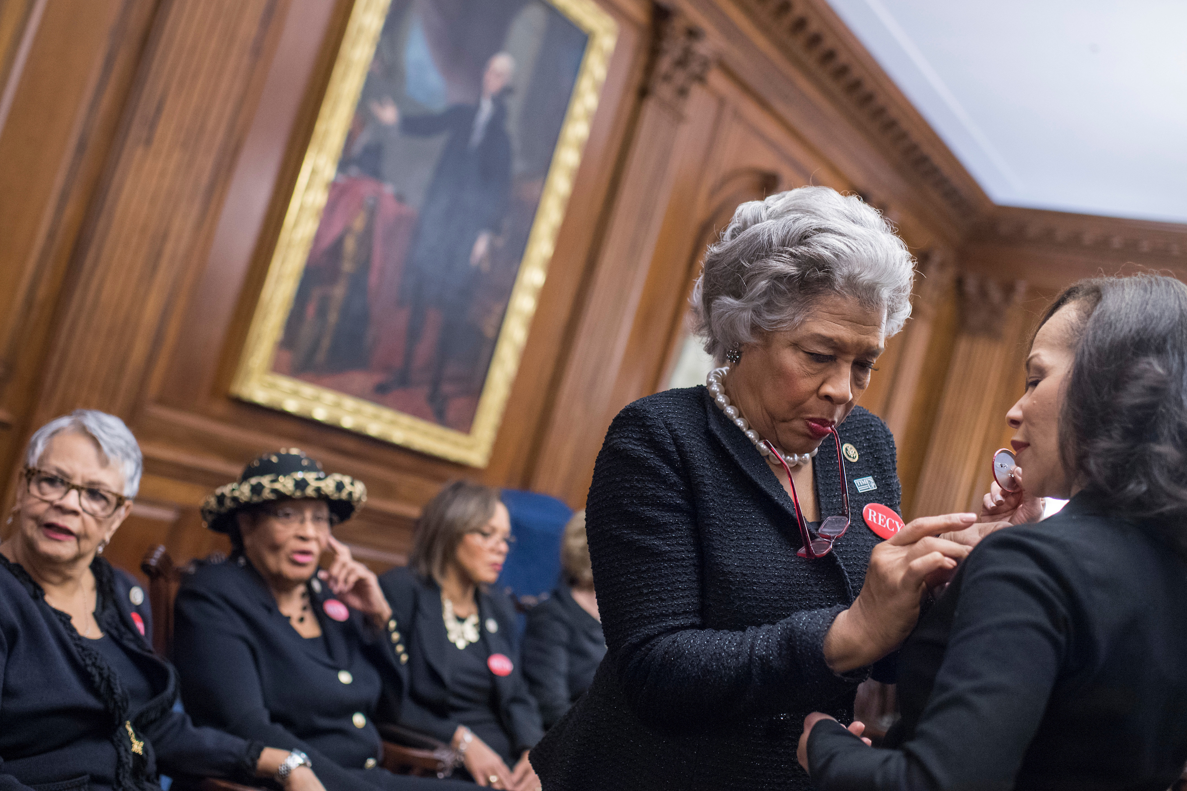 From left, Reps. Bonnie Watson Coleman, D-N.J., Alma Adams, D-N.C., Robin Kelly, D-Ill., Joyce Beatty, D-Ohio, and Lisa Blunt Rochester, D-Del., wear black during a photo op in the Capitol's Rayburn Room to show solidarity with men and women who are speaking out against sexual harassment and discrimination. (Tom Williams/CQ Roll Call)
