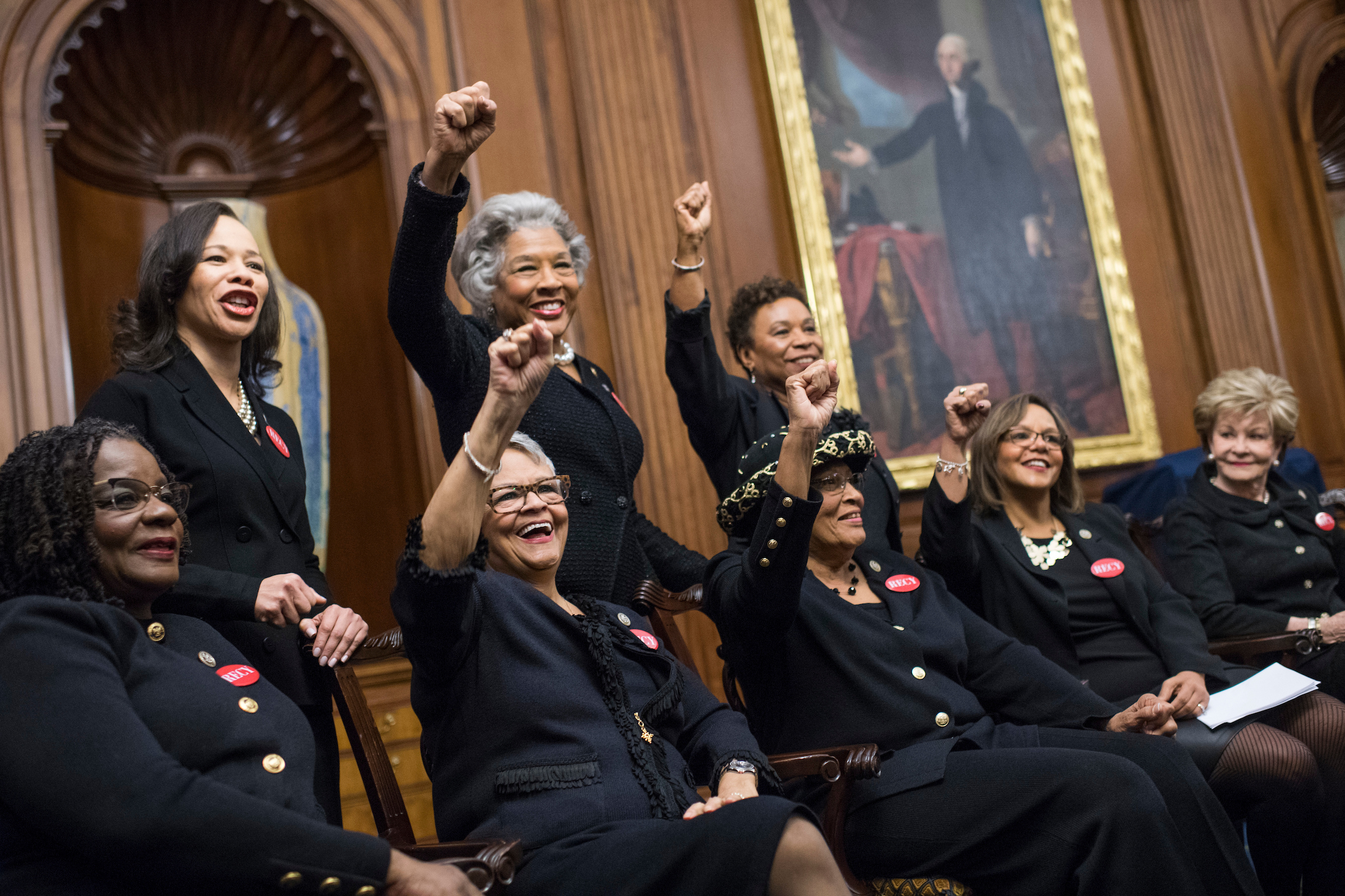 From left, Reps. Gwen Moore, D-Wis., Lisa Blunt Rochester, D-Del., Bonnie Watson Coleman, D-N.J., Joyce Beatty, D-Ohio, Alma Adams, D-N.C., Barbara Lee, D-Calif., Robin Kelly, D-Ill., and Del. Madeleine Bordallo, D-Guam, wear black during a photo op in the Capitol's Rayburn Room to show solidarity with men and women who are speaking out against sexual harassment and discrimination on January 30, 2018. (Photo By Tom Williams/CQ Roll Call)