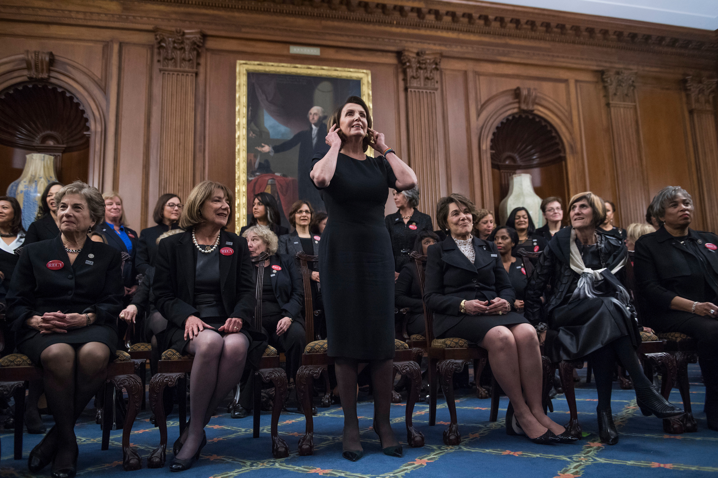 Front row from left, Reps. Jan Schakowsky, D-Ill., Susan Davis, D-Calif., House Minority Leader Nancy Pelosi, D-Calif., Anna Eshoo, D-Calif., Rosa DeLauro, D-Conn., and Brenda Lawrence, D-Mich., wear all black during a photo op in the Capitol's Rayburn Room to show solidarity with men and women who are speaking out against sexual harassment and discrimination on January 30, 2018. (Photo By Tom Williams/CQ Roll Call)