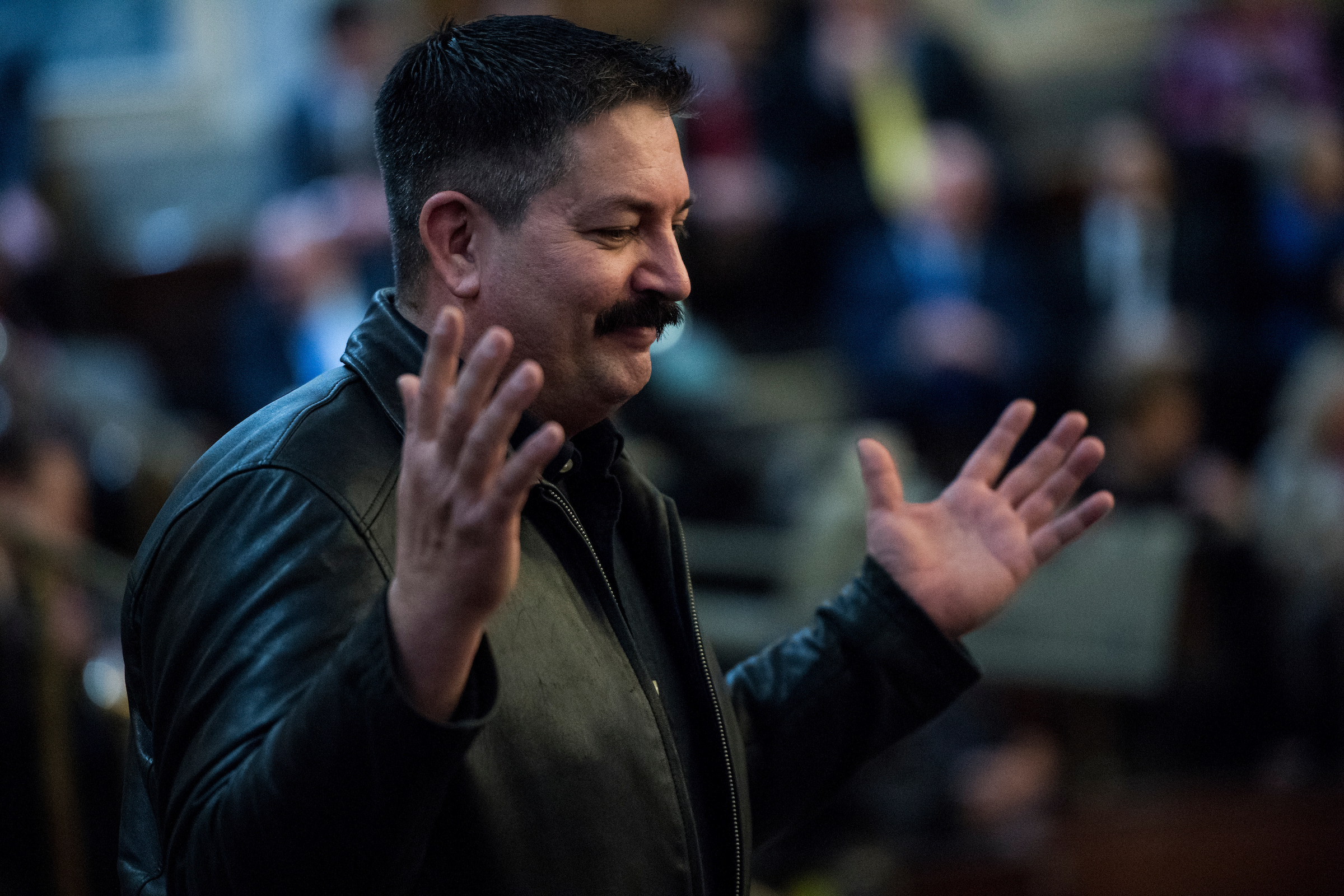 UNITED STATES - JANUARY 30: Randy Bryce, Democratic challenger to Speaker of the House Paul Ryan in Wisconsin's 1st Congressional District, gestures to fellow Democrats from the visitors gallery before the start of President Donald Trumps' State of the Union Address to the joint session of Congress in the Capitol on Tuesday, Jan. 30, 2018. (Photo By Bill Clark/CQ Roll Call)