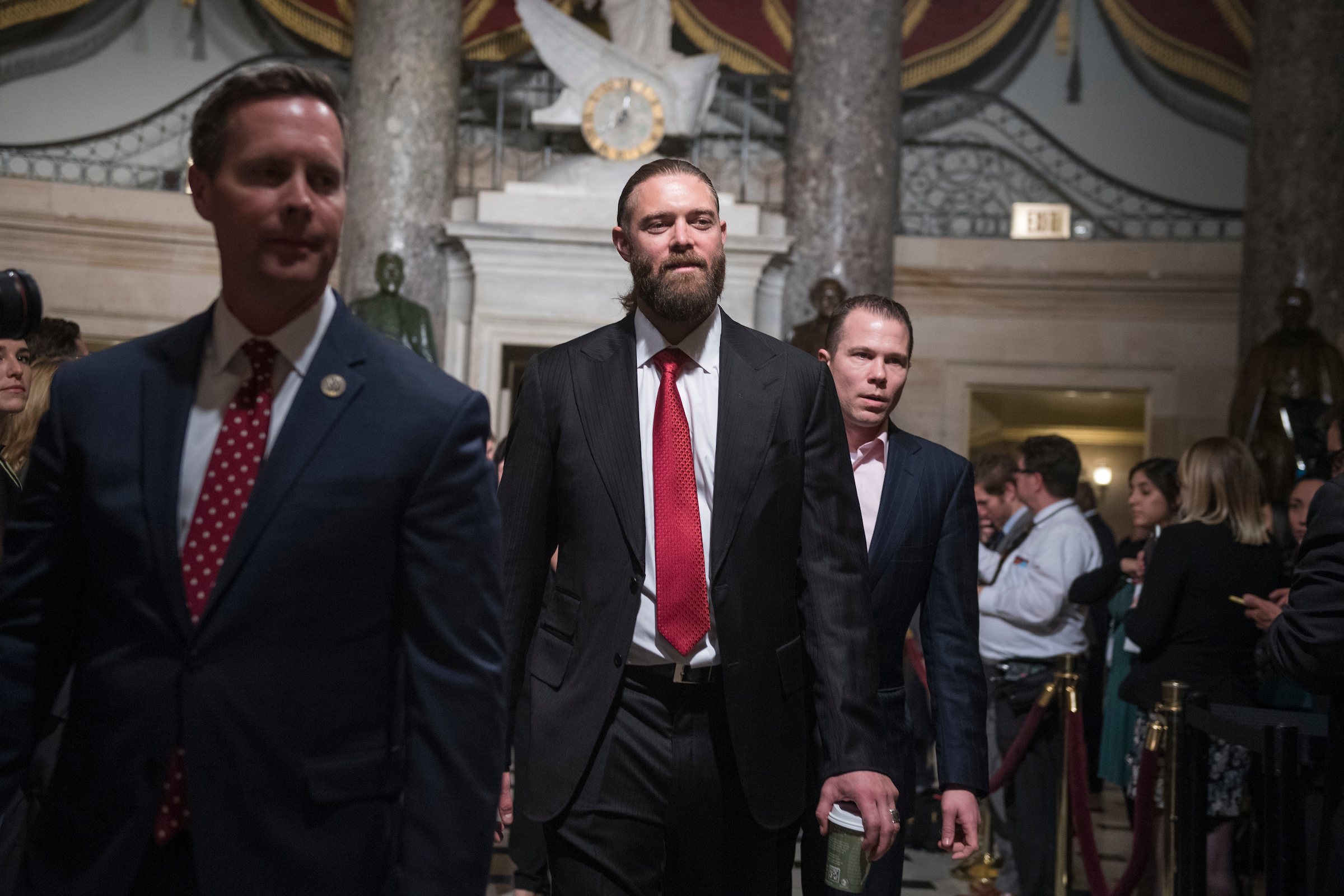 UNITED STATES - JANUARY 30: Former Washington National Jayson Werth, center, walks through Statuary Hall with his host Rep. Rodney Davis, R-Ill., left, before President Donald Trump's State of the Union address to a joint session of Congress in the House chamber on January 30, 2018. (Photo By Tom Williams/CQ Roll Call)