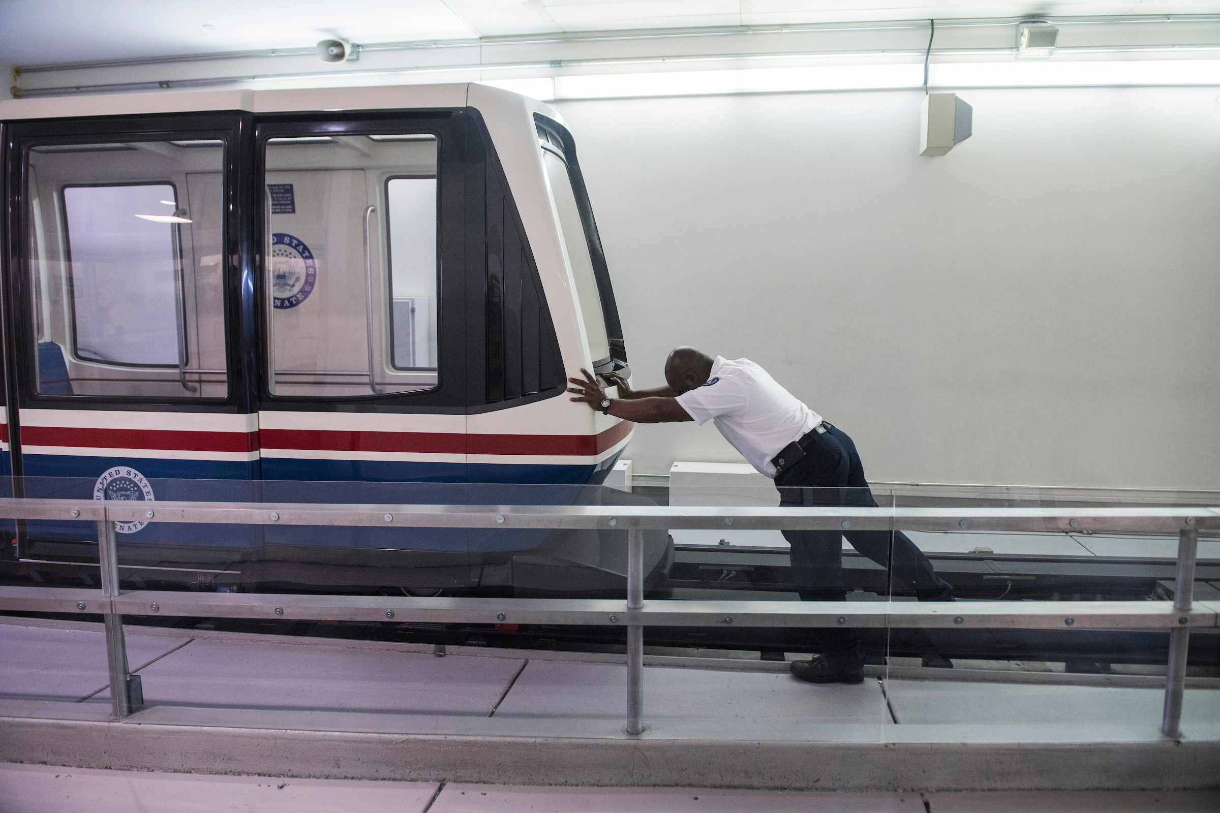 UNITED STATES - JANUARY 19: A worker pushes a senate subway car Friday morning as the Senate considers the House passed continuing resolution to fund the government on January 19, 2018. (Photo By Tom Williams/CQ Roll Call)
