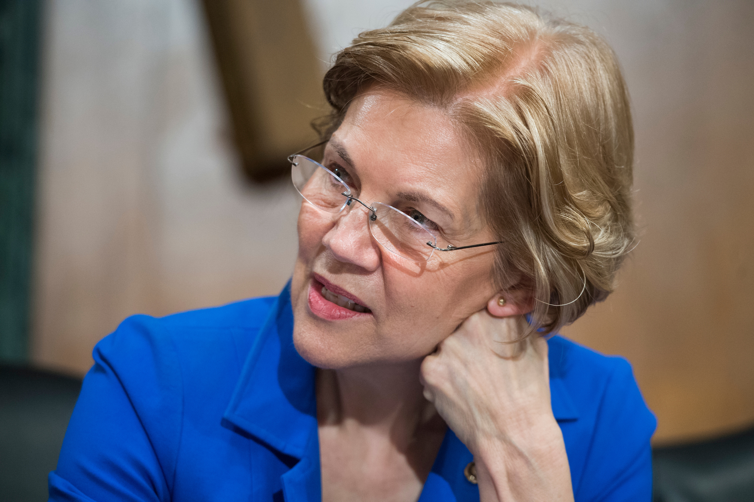 UNITED STATES - JANUARY 23: Sen. Elizabeth Warren, D-Mass., is seen during a Senate Banking, Housing and Urban Affairs Committee hearing in Dirksen Building on the nominations of Jelena McWilliams, Marvin Goodfriend, and Thomas Workman on January 23, 2018. (Photo By Tom Williams/CQ Roll Call)