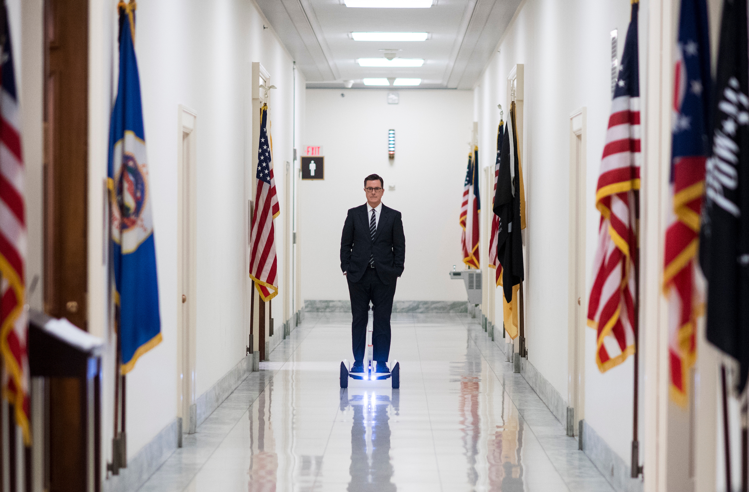 Stephen Colbert rides a Segway down the hallway outside of Rep. Adam Schiff's office in the Rayburn House Office Buidling on Tuesday, Feb. 13, 2018. Colbert was on Capitol Hill for an interview with Rep. Schiff. (Photo By Bill Clark/CQ Roll Call)