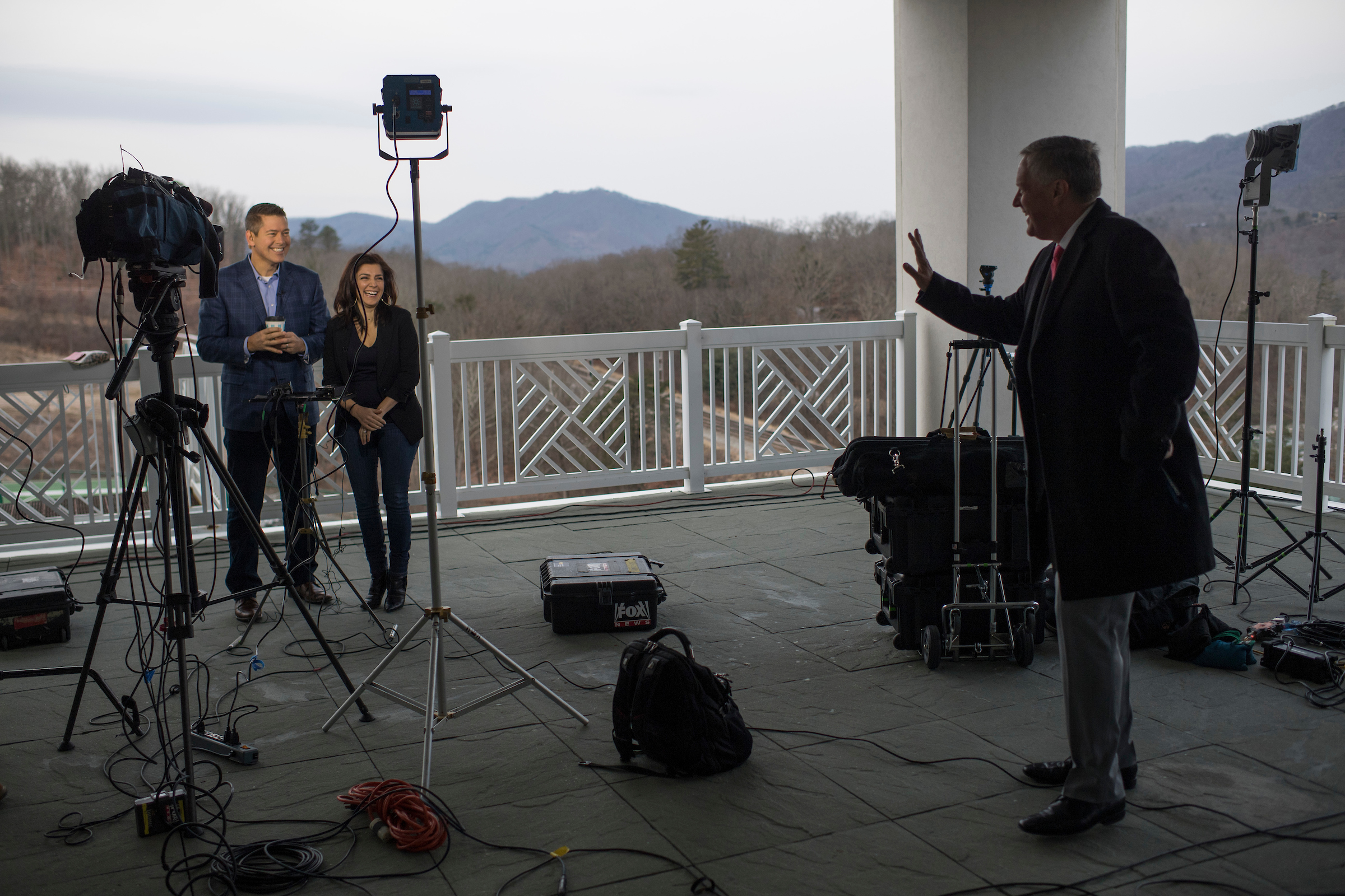 UNITED STATES - FEBRUARY 01: Rep. Mark Meadows, R-N.C., right, talks with Rep. Sean Duffy, R-Wis., and his wife Rachel Campos-Duffy at the media center during House and Senate Republican retreat at The Greenbrier resort in White Sulphur Springs, W.Va., on February 1, 2018. (Photo By Tom Williams/CQ Roll Call)