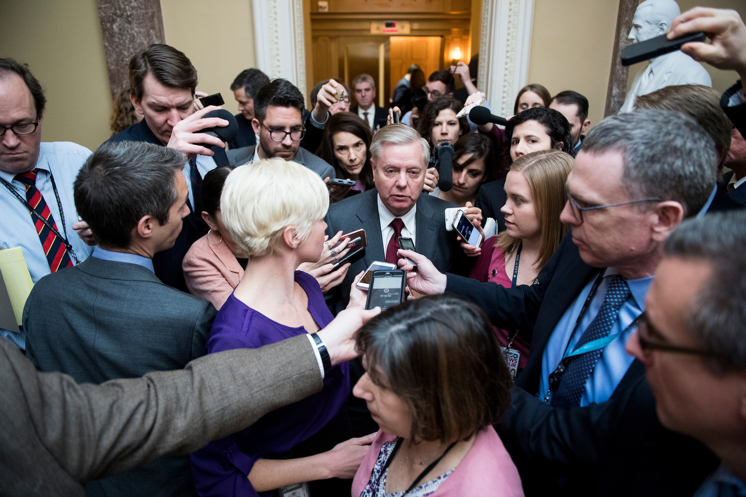 Reporters swarm around Sen. Lindsey Graham, R-S.C., has he leaves the Senate Republicans' policy lunch in the Capitol on Tuesday, Feb. 6, 2018. (Photo By Bill Clark/CQ Roll Call)