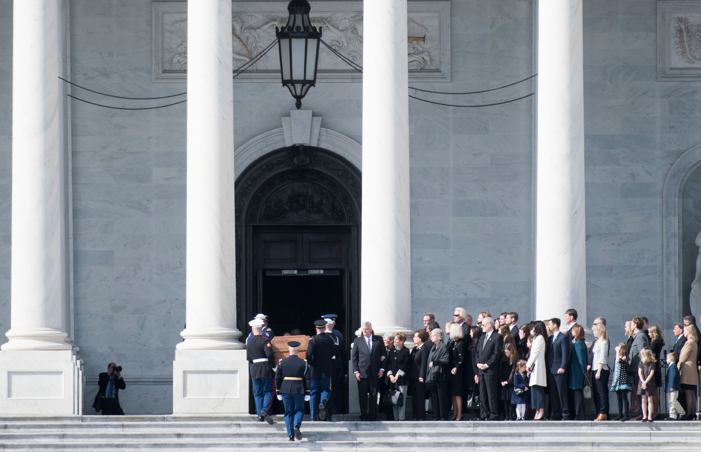 The honor guard carries the Rev. Billy Graham's casket up the Capitol steps to the Rotunda where he will lie in honor on Wednesday, Feb. 28, 2018. (Bill Clark/CQ Roll Call)