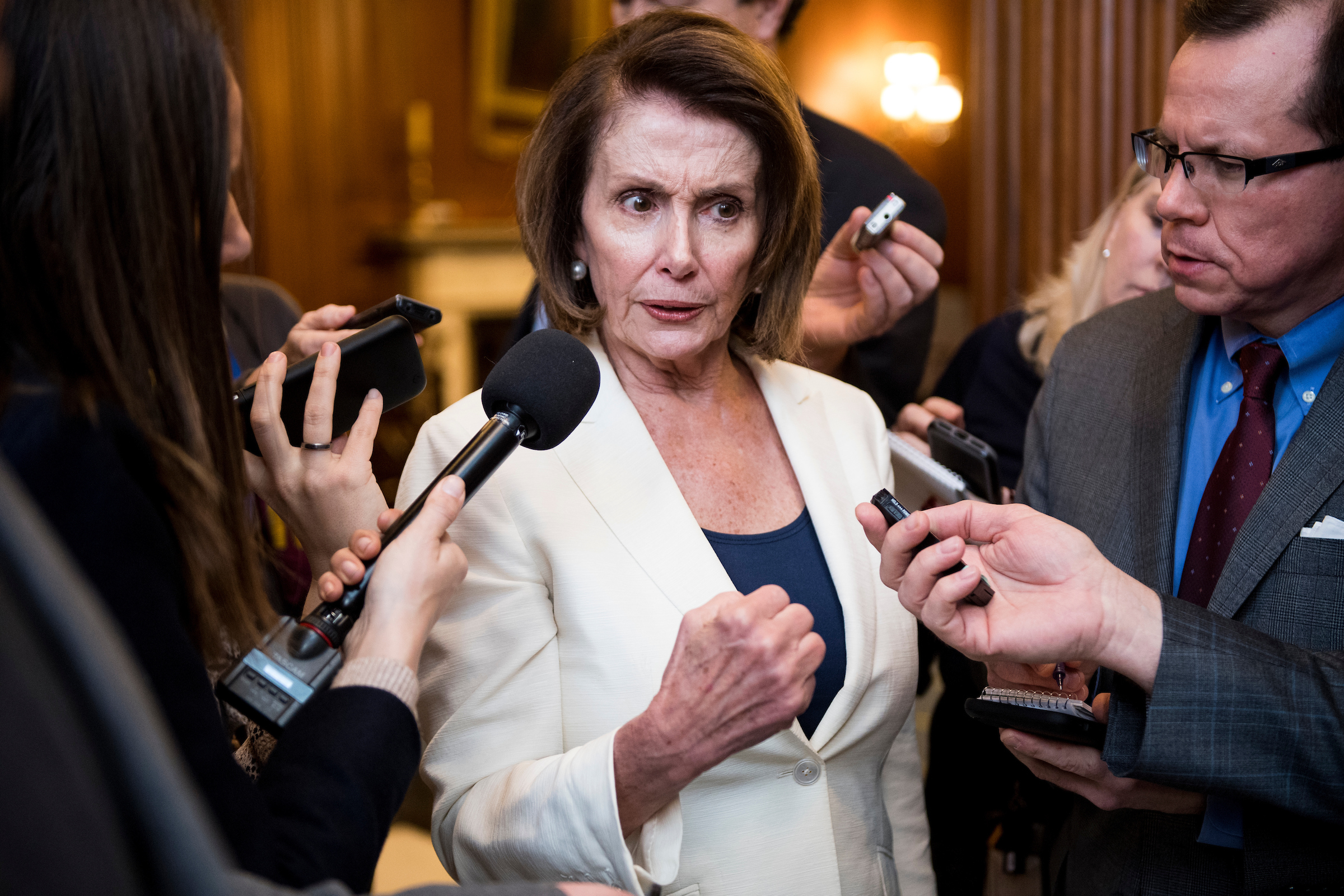 """House Minority Leader Nancy Pelosi spoke for over eight hours on the floor Wednesday, telling the stories of """"Dreamers."""" Her record-breaking speech overshadowed the opening day of the House Democrats' annual retreat, including former Vice President Joseph R. Biden Jr.'s advice to the caucus to """"holler more loudly."""" (Bill Clark/CQ Roll Call)"""