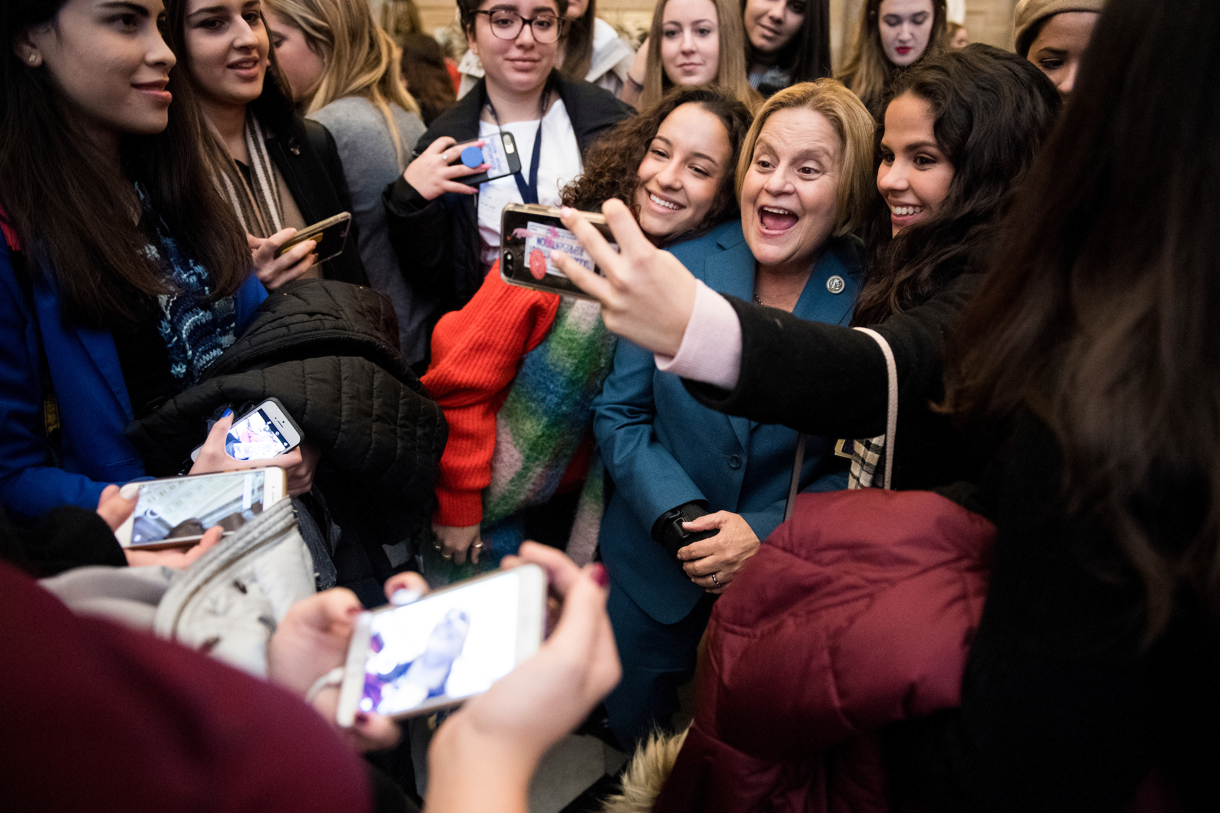 UNITED STATES - FEBRUARY 7: Rep. Ileana Ros-Lehtinen, R-Fla., poses for selfies in Statuary Hall with female students touring the Capitol as part of the Closeup Foundation program on Wednesday, Feb. 7, 2018. Rep. Ileana Ros-Lehtinen, Rep. Carlos Curbelo and Rep. Debbie Wasserman Schultz also spoke to the group in Statuary Hall. (Photo By Bill Clark/CQ Roll Call)