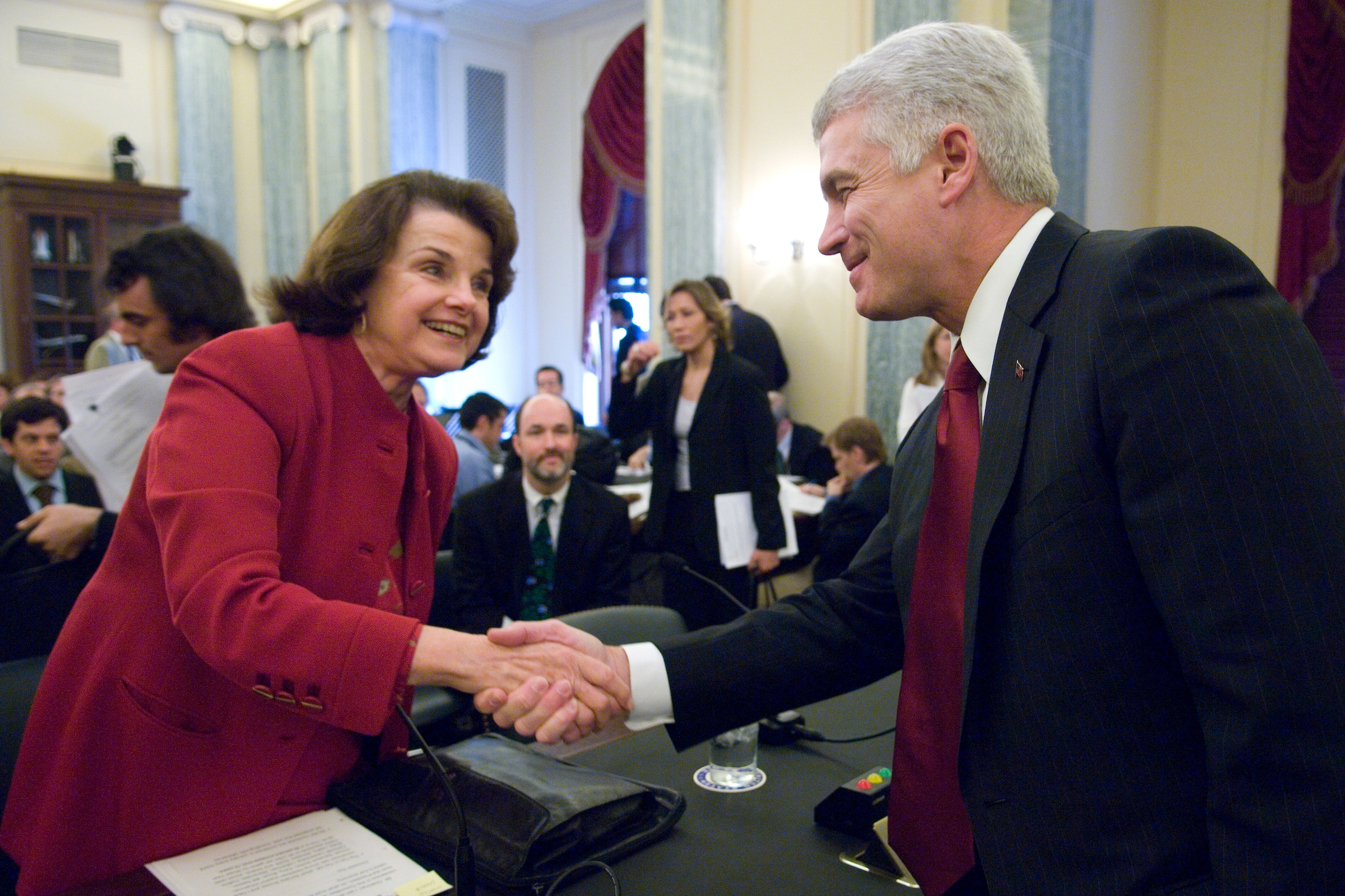 "David McCurdy, president of the Alliance of Automobile Manufacturers, shakes hands with Sen. Dianne Feinstein, D-Calif., before the start of the Senate Commerce, Science and Transportation Committee hearing on the ""Pending Corporate Average Fuel Economy (CAFE) Legislation"" on Thursday, May 3, 2007."