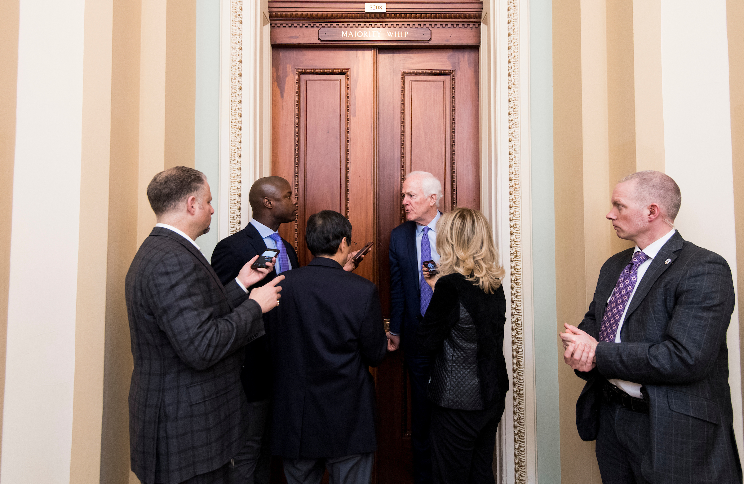 : Sen. John Cornyn, R-Texas, speaks with reporters outside of his office in the Capitol on Wednesday, Feb. 28, 2018. (Photo By Bill Clark/CQ Roll Call)