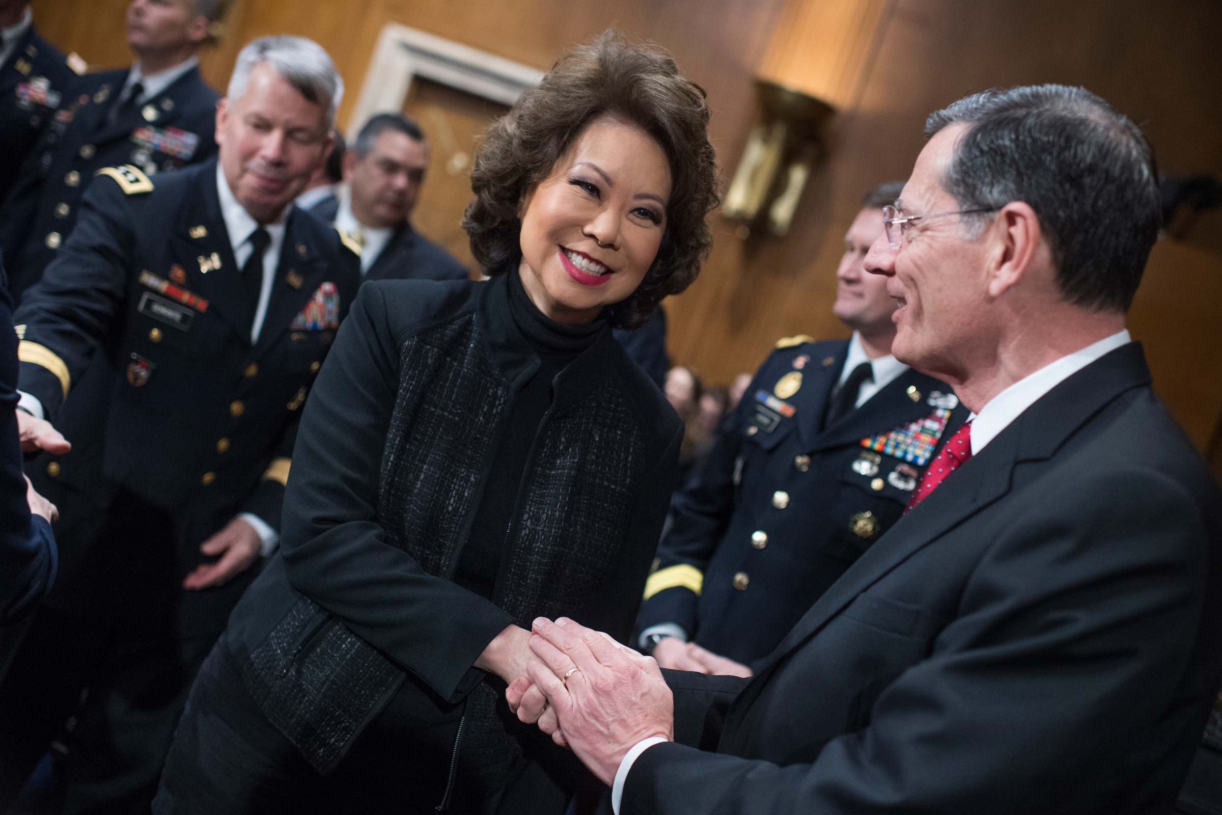 "UNITED STATES - MARCH 01: Transportation Secretary Elaine Chao greets Chairman John Barrasso, R-Wyo., before a Senate Environment and Public Works Senate Committee hearing in Dirksen Building titled ""The Administration's Framework for Rebuilding Infrastructure in America"" on March 01, 2018. (Photo By Tom Williams/CQ Roll Call)"