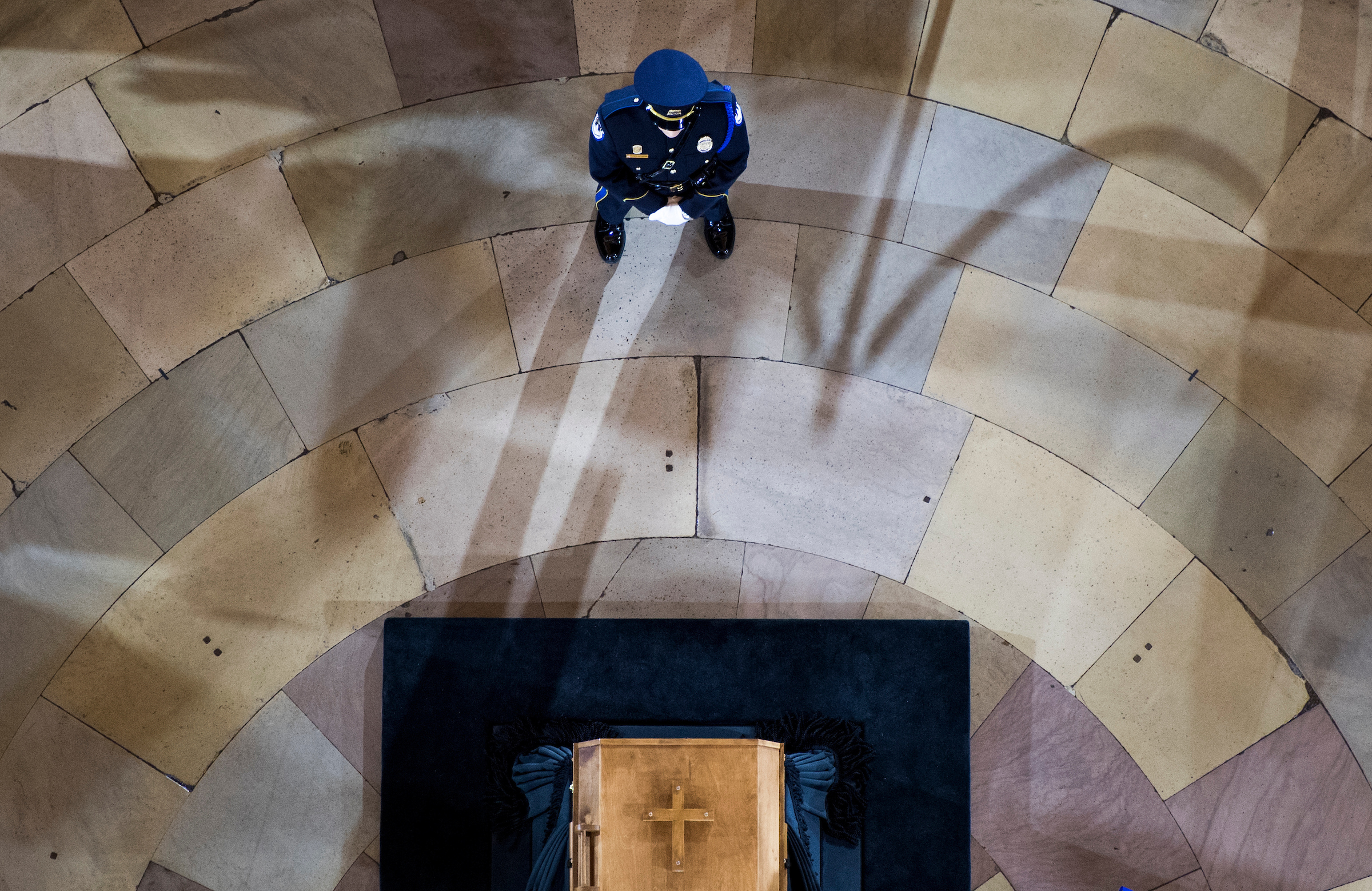 UNITED STATES - FEBRUARY 28: A U.S. Capitol Police officer stands guard at Rev. Billy Graham's casket as his body lies in honor in the Capitol Rotunda on Wednesday, Feb. 28, 2018. (Photo By Bill Clark/CQ Roll Call)