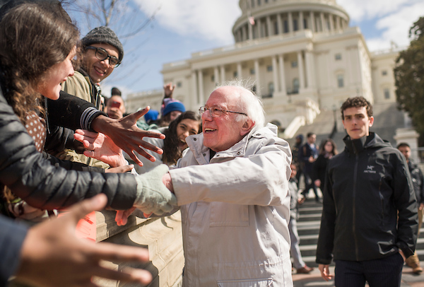 UNITED STATES - MARCH 14: Sen. Bernie Sanders, I-Vt., greets students while attending a rally on the West Front of the Capitol during a national walkout by students to call on Congress to act on gun violence prevention on March 14, 2018. (Photo By Tom Williams/CQ Roll Call)