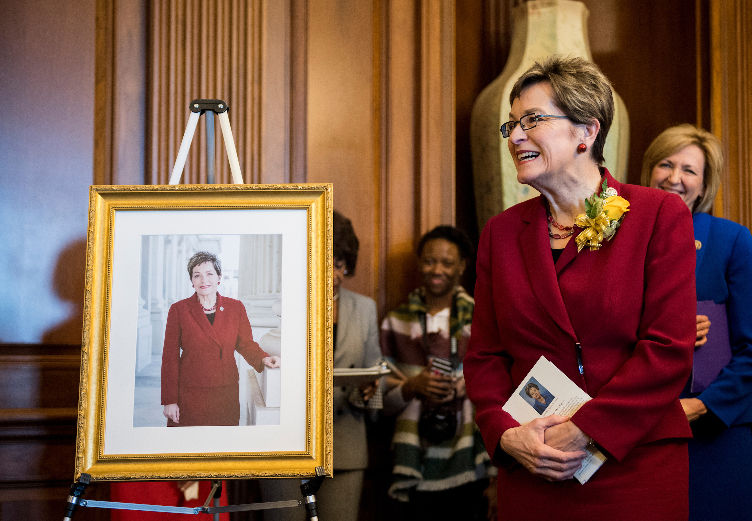 Rep. Marcy Kaptur, D-Ohio, stands next to a picture of herself as House Minority Leader Nancy Pelosi, D-Calif., hosts a reception in Kaptur's honor in the Capitol on Wednesday, March 14, 2018. The reception was held to honor Rep. Kaptur's passing the milestone as the longest-serving woman in House history. She will be breaking the record currently held by Rep. Edith Nourse Rogers, R-Mass., on Sunday, March 18. (Photo By Bill Clark/CQ Roll Call)